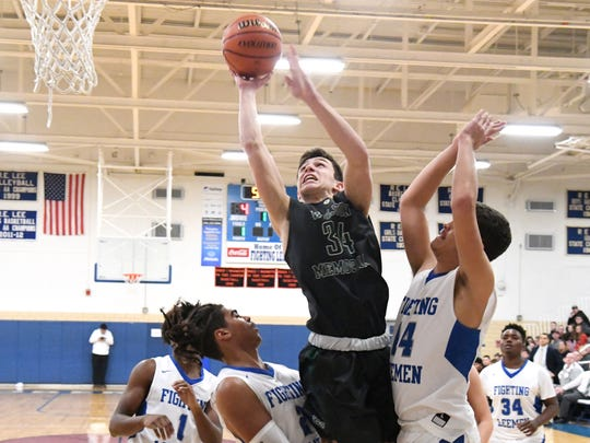 Wilson Memorial's Gabriel LaGrua takes the ball up and shoots as he feels Robert E. Lee defensive pressure during a game played in Staunton on Friday, Jan. 18, 2019.