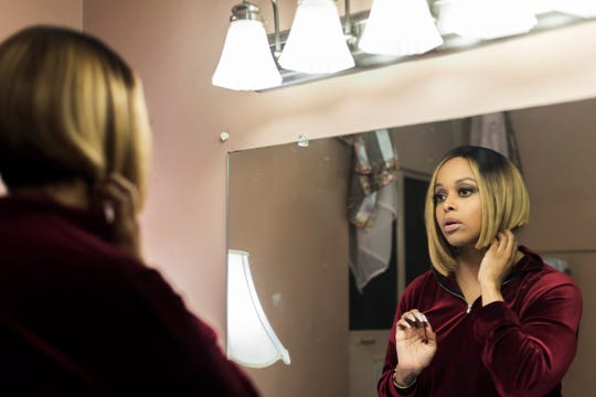 Chrisette Michele gets ready in the backroom before her concert at the Keswick Theater in Glenside, Pennsylvania, a few days after Christmas. Since singing at one of Donald Trump's inaugural balls, Michele is singing to nearly empty audiences. She says she's finding a new path to happiness.