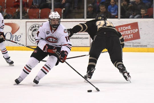St. Cloud State senior forward Patrick Newell skates past a Western Michigan defender at the Herb Brooks National Hockey Center.