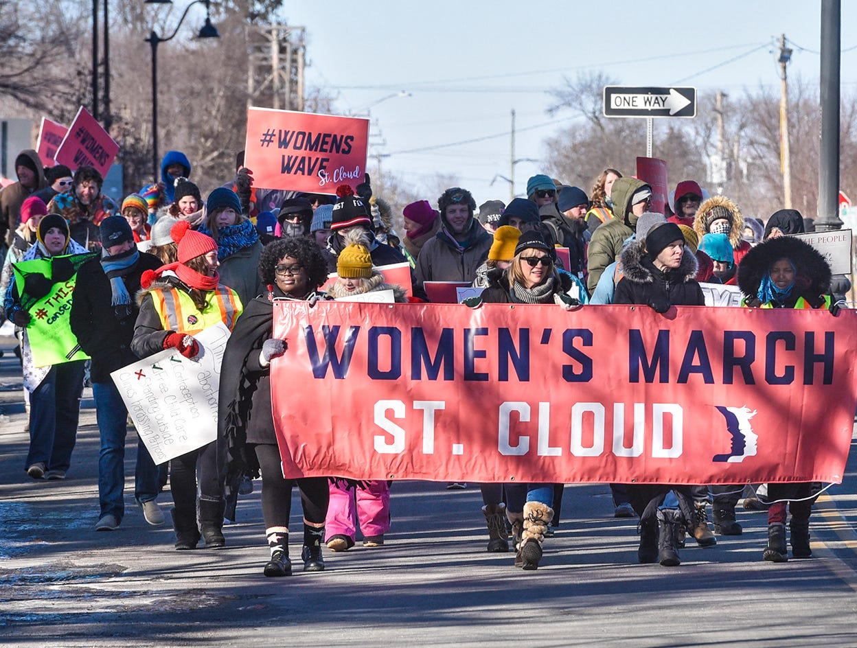 Marchers make their way to Tech High School during the WomensWave march Saturday, Jan. 19, in St. Cloud.