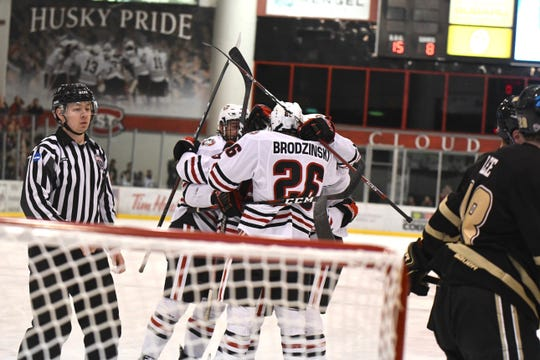 St. Cloud State sophomore forward Easton Brodzinski celebrates with teammates after the Huskies extended their lead against Western Michigan at the Herb Brooks National Hockey Center.