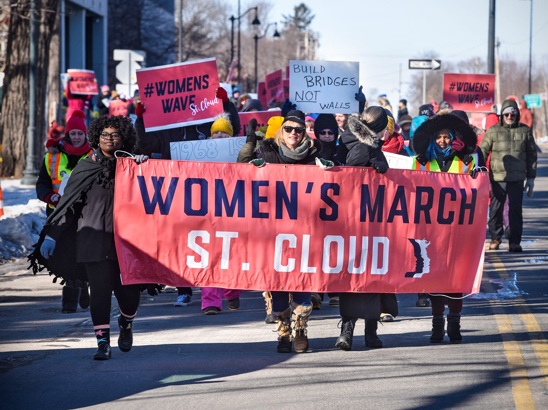 Participants brave cold temperatures to take part in the WomensWave march Saturday, Jan. 19, in St. Cloud. The local event was part of national Women's March activities taking place throughout the nation Saturday.
