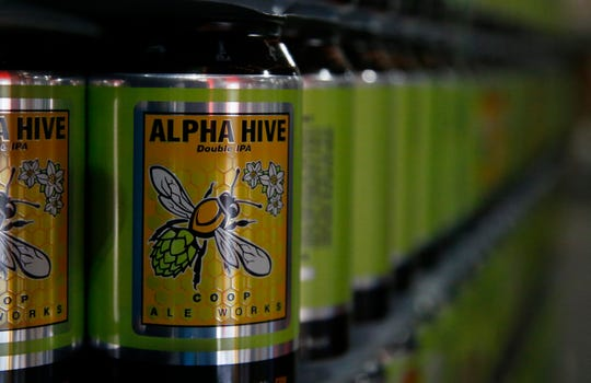 Cans of spring seasonal Alpha Hive Double IPA are ready to be filled with beer at COOP Ale Works in Oklahoma City, Friday, Jan. 18, 2019.