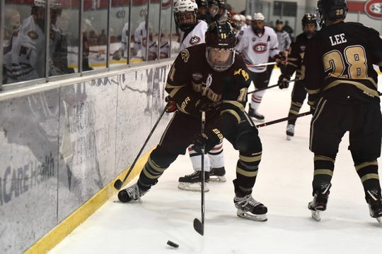 Western Michigan freshman forward Rhett Kingston comes away with the puck against St. Cloud State at the Herb Brooks National Hockey Center.