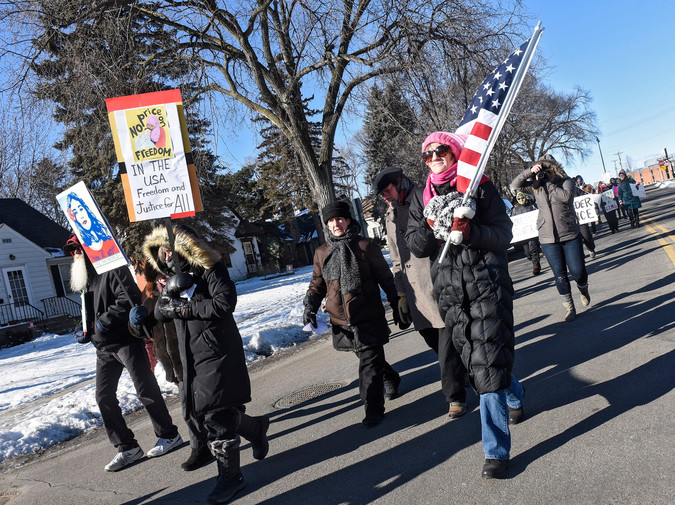 Participants walk toward Tech High School during the WomensWave march Saturday, Jan. 19, in St. Cloud.