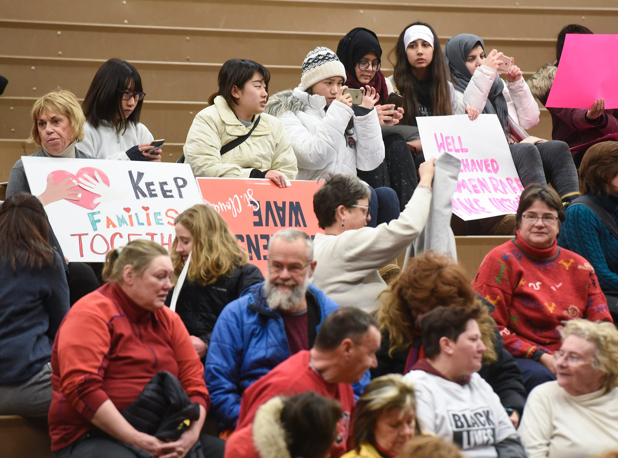 Participants gather in the Tech High School gymnasium following the WomensWave march Saturday, Jan. 19, in St. Cloud.