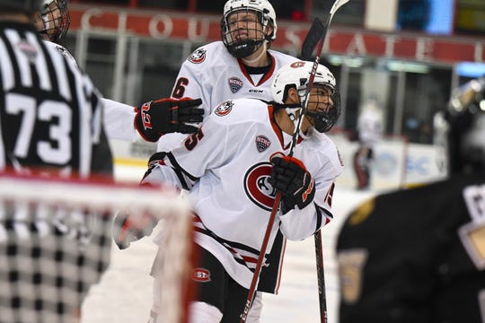 St. Cloud State's Will Hammer and Micah Miller are all smiles after Miller scored his first career goal against Western Michigan at the Herb Brooks National Hockey Center.