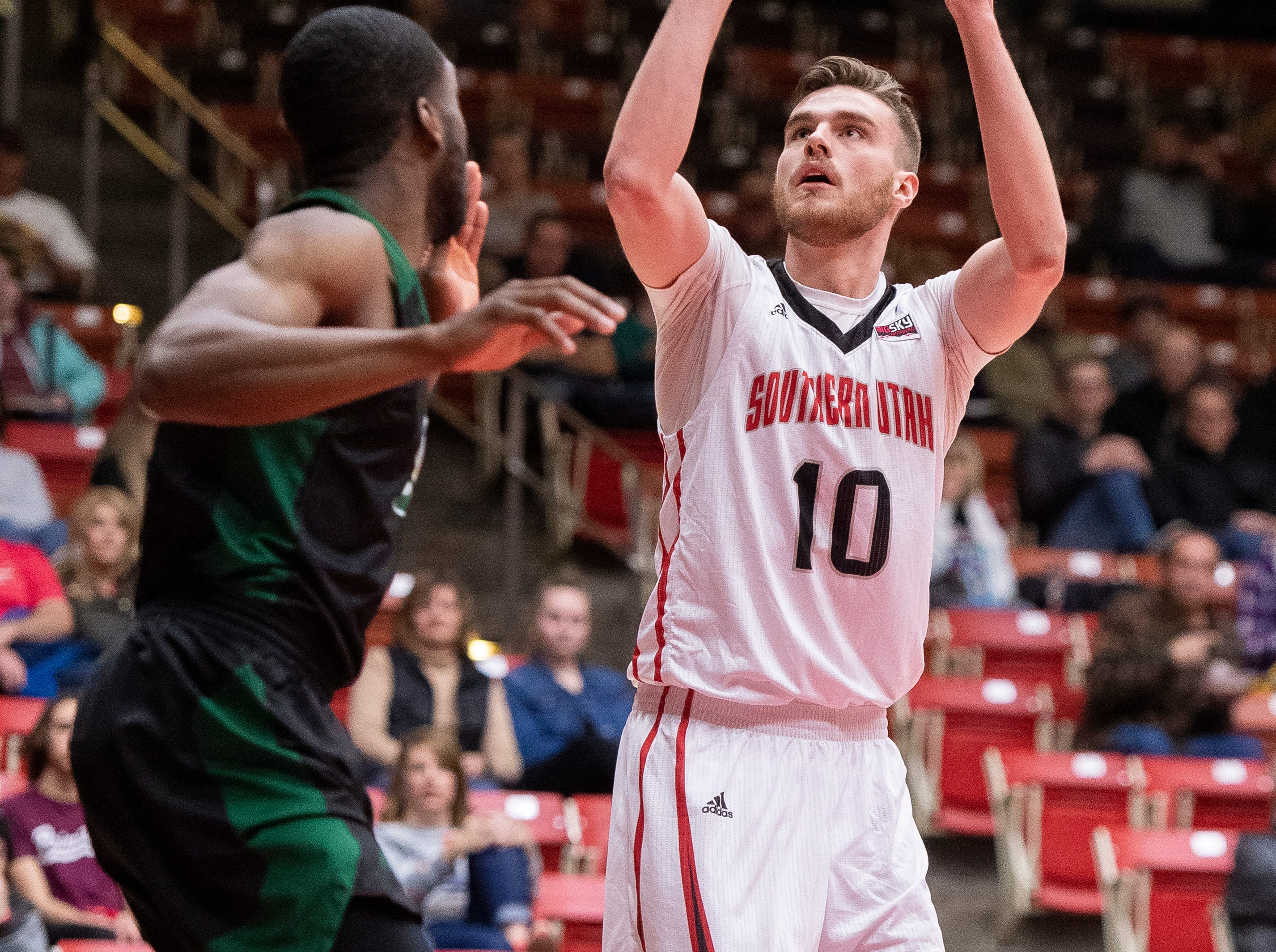 Southern Utah University junior Jacob Calloway (10) takes a shot against Sacramento State in the America First Event Center Saturday, January 19, 2019.
