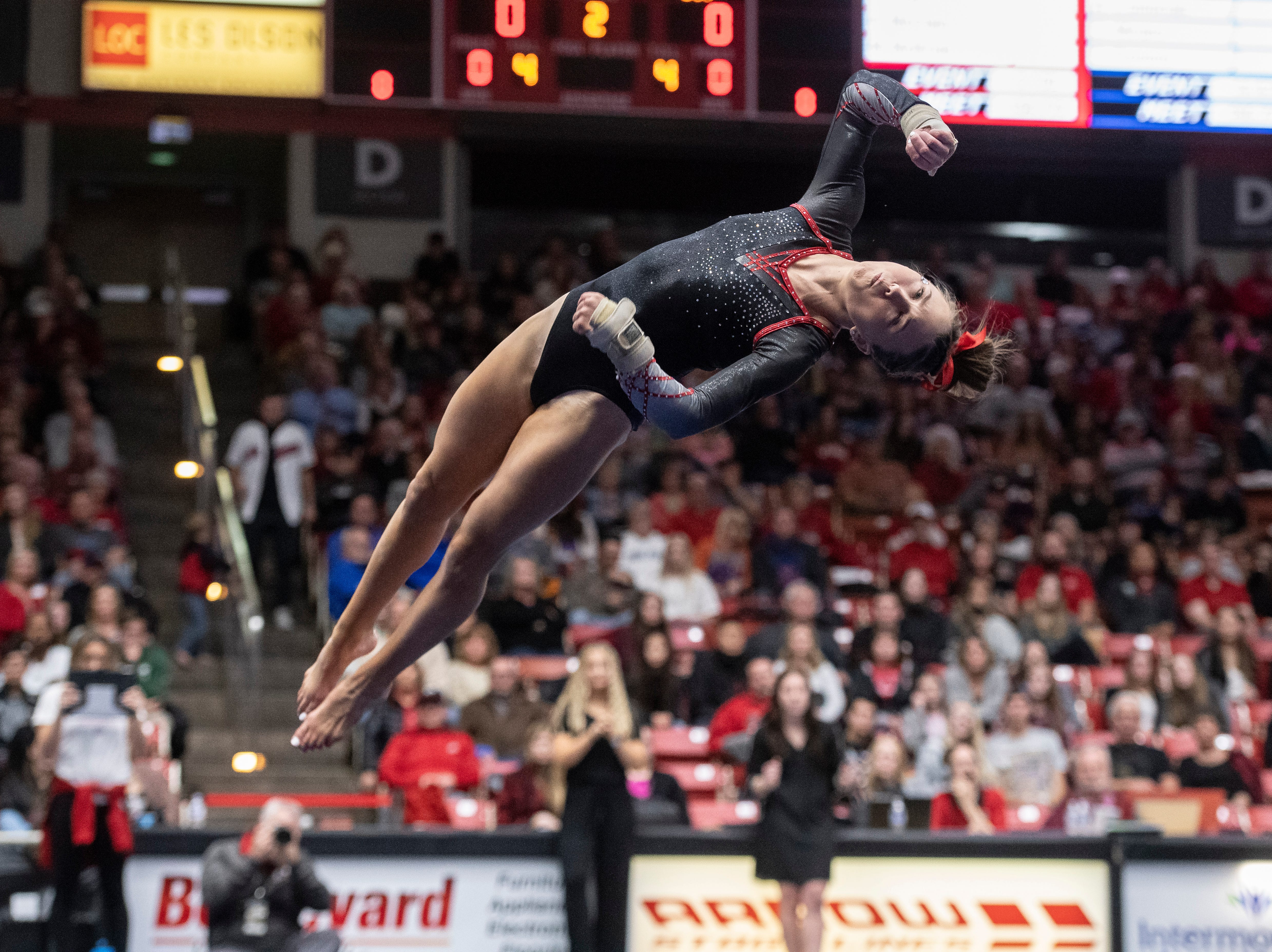 Southern Utah University sophomore Molly Jozwiakowski flies through the air during her floor routine against Boise State at the America First Event Center Friday, January 18, 2019.