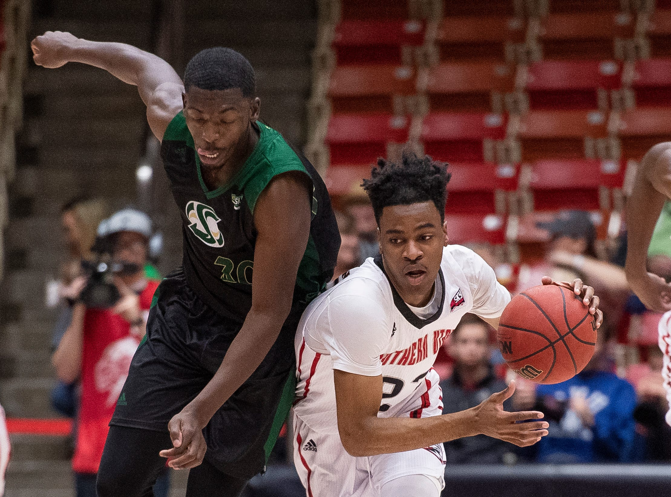 Southern Utah University junior Cameron Oluyitan (23) steals the ball from Sacramento State in the America First Event Center Saturday, January 19, 2019.
