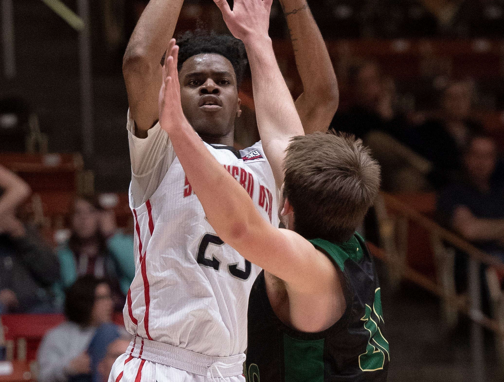 Southern Utah University junior Cameron Oluyitan (23) takes a shot against Sacramento State in the America First Event Center Saturday, January 19, 2019.