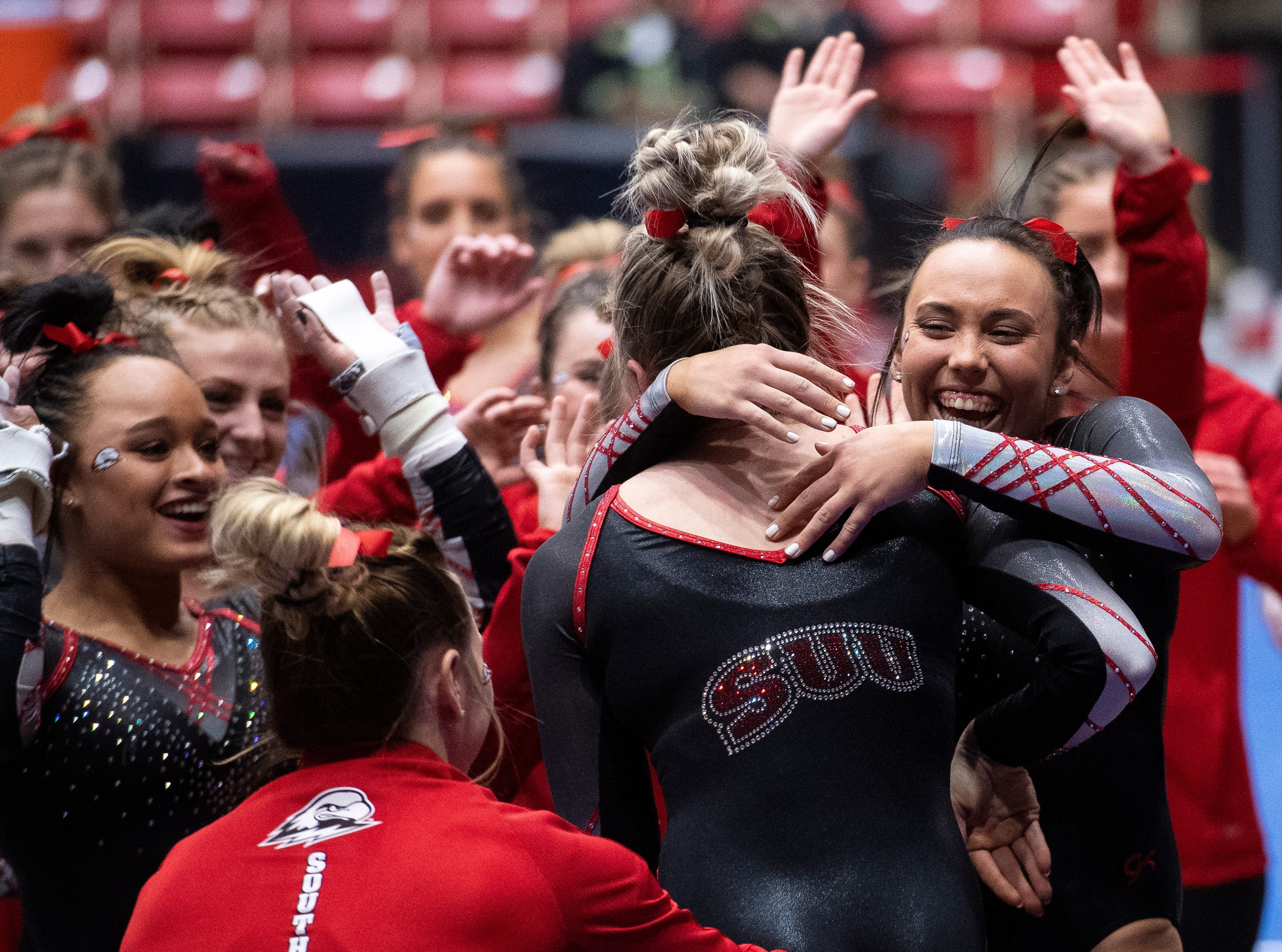 The Flippin' Birds celebrate after freshman Stephanie Tervort competes on the vault against Boise State at the America First Event Center Friday, January 18, 2019.
