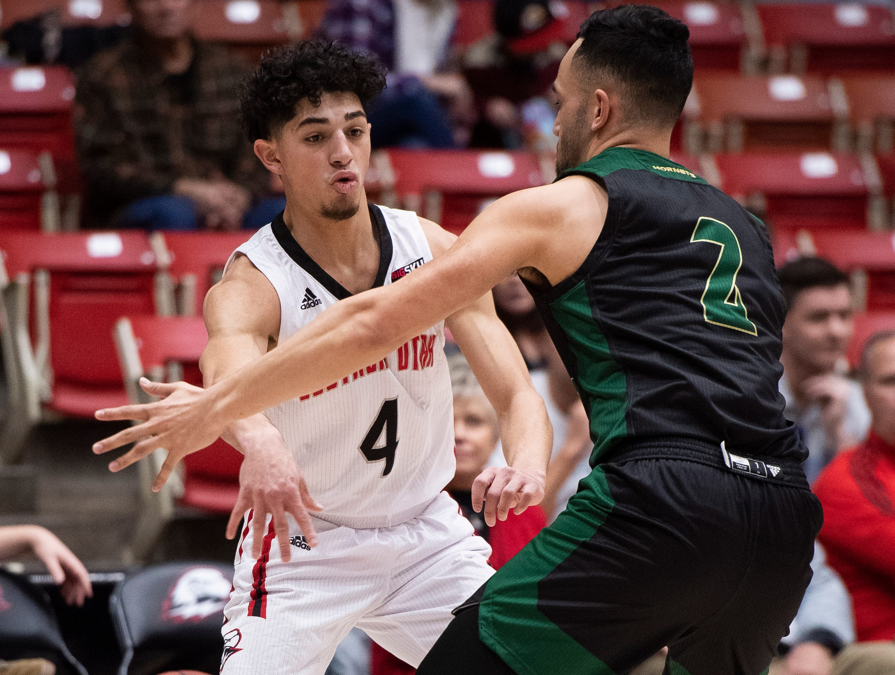 Southern Utah University sophomore Dre Marin (4) throws a bounce pass against Sacramento State in the America First Event Center Saturday, January 19, 2019.