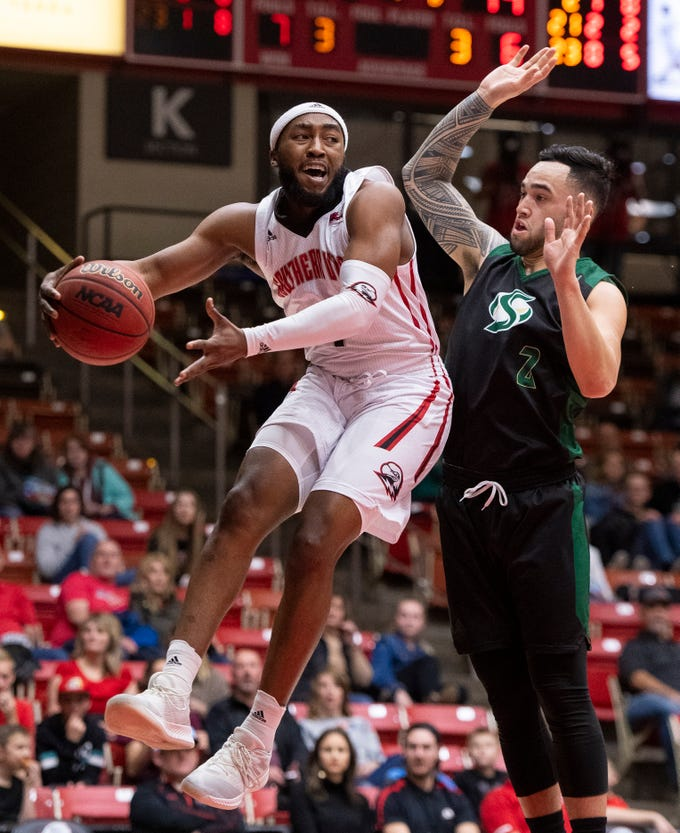 Southern Utah University freshman Kenton Eskridge (1) keeps the ball in-bounds against Sacramento State in the America First Event Center Saturday, January 19, 2019.