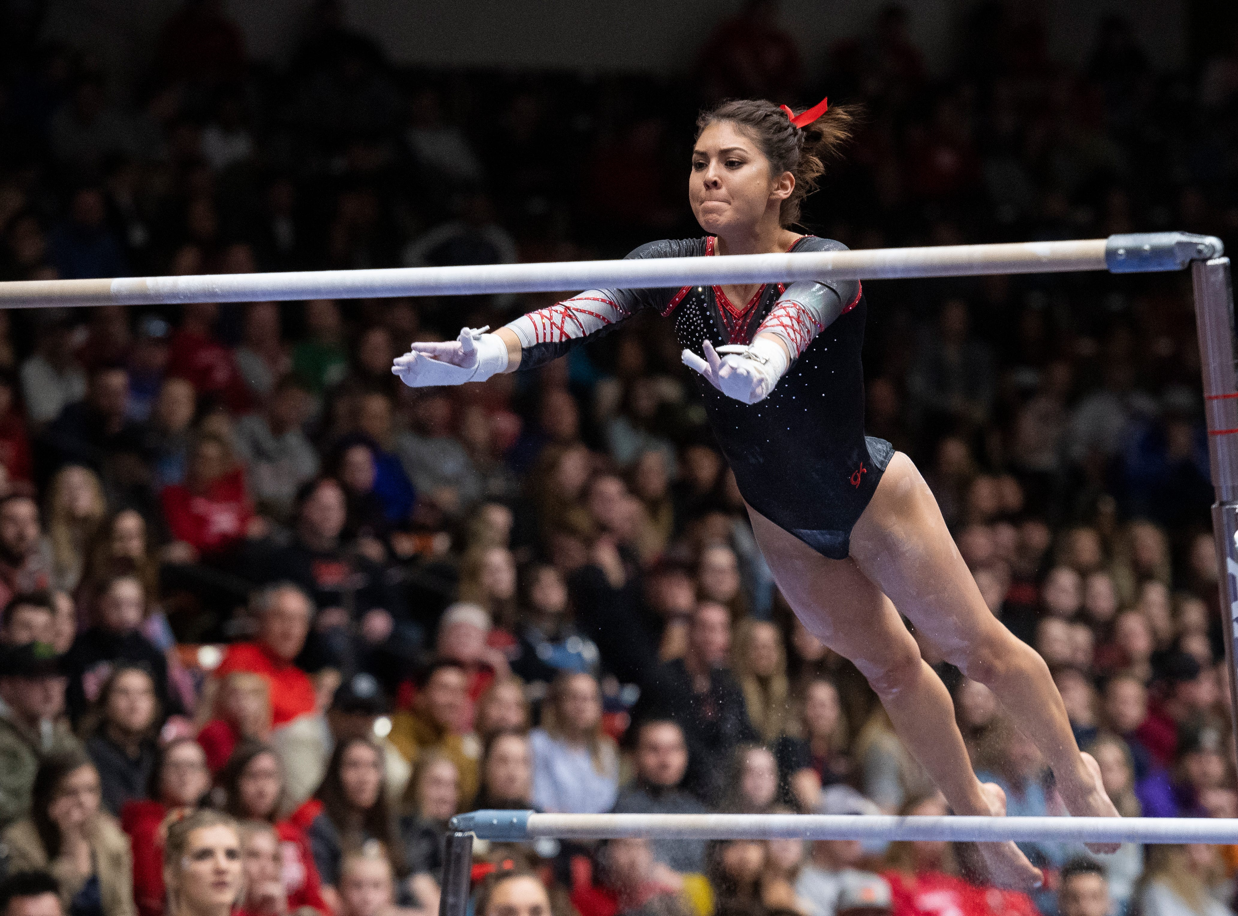 Southern Utah University senior Karen Gonzalez begins her routine on the uneven bars against Boise State at the America First Event Center Friday, January 18, 2019.