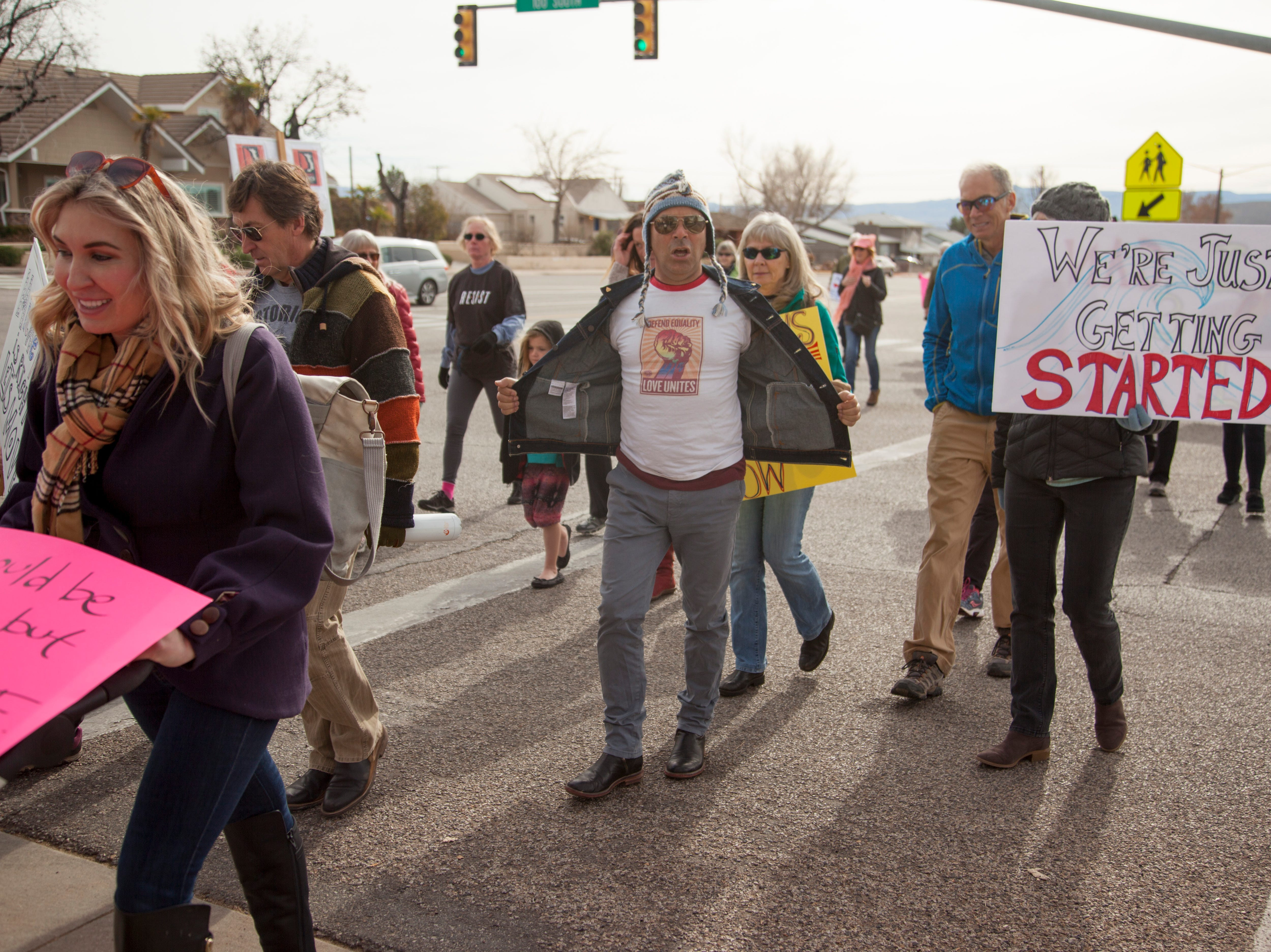 Members of the community participate in the St. George Women's March Saturday, Jan. 19, 2019.