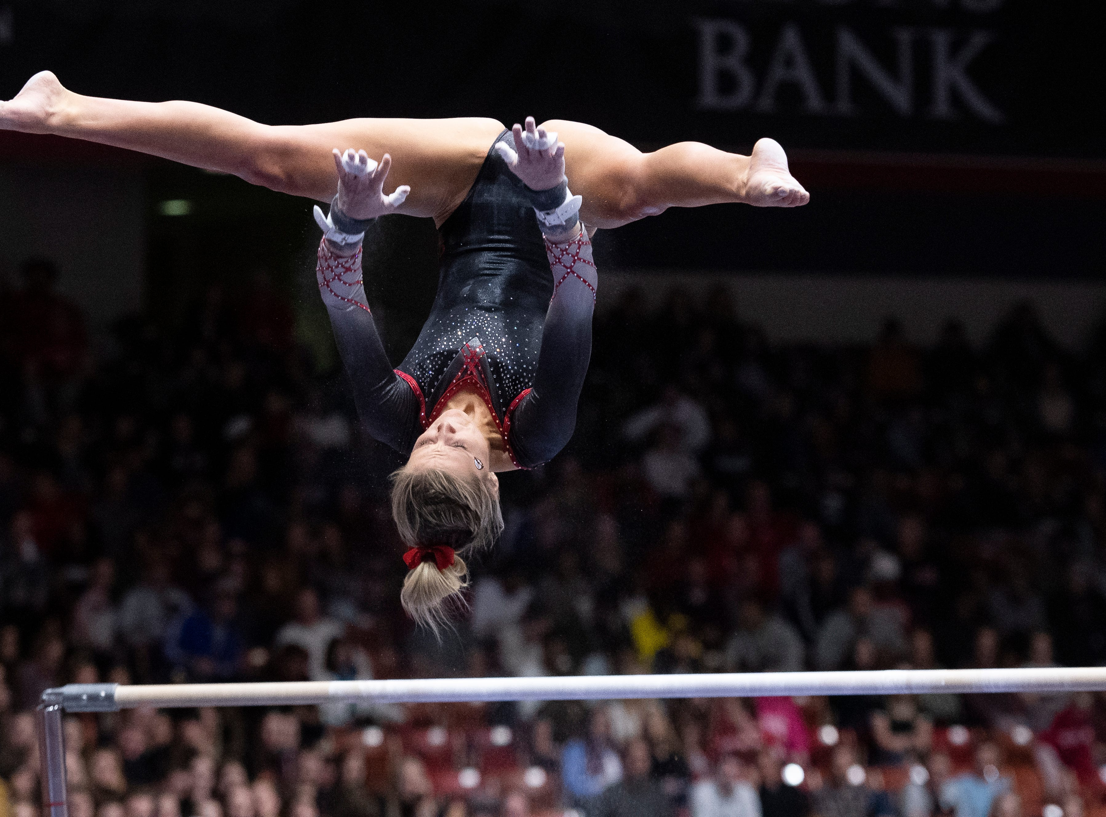 Southern Utah University junior Becky Rozsa-Thompson competes on the uneven bars against Boise State at the America First Event Center Friday, January 18, 2019.