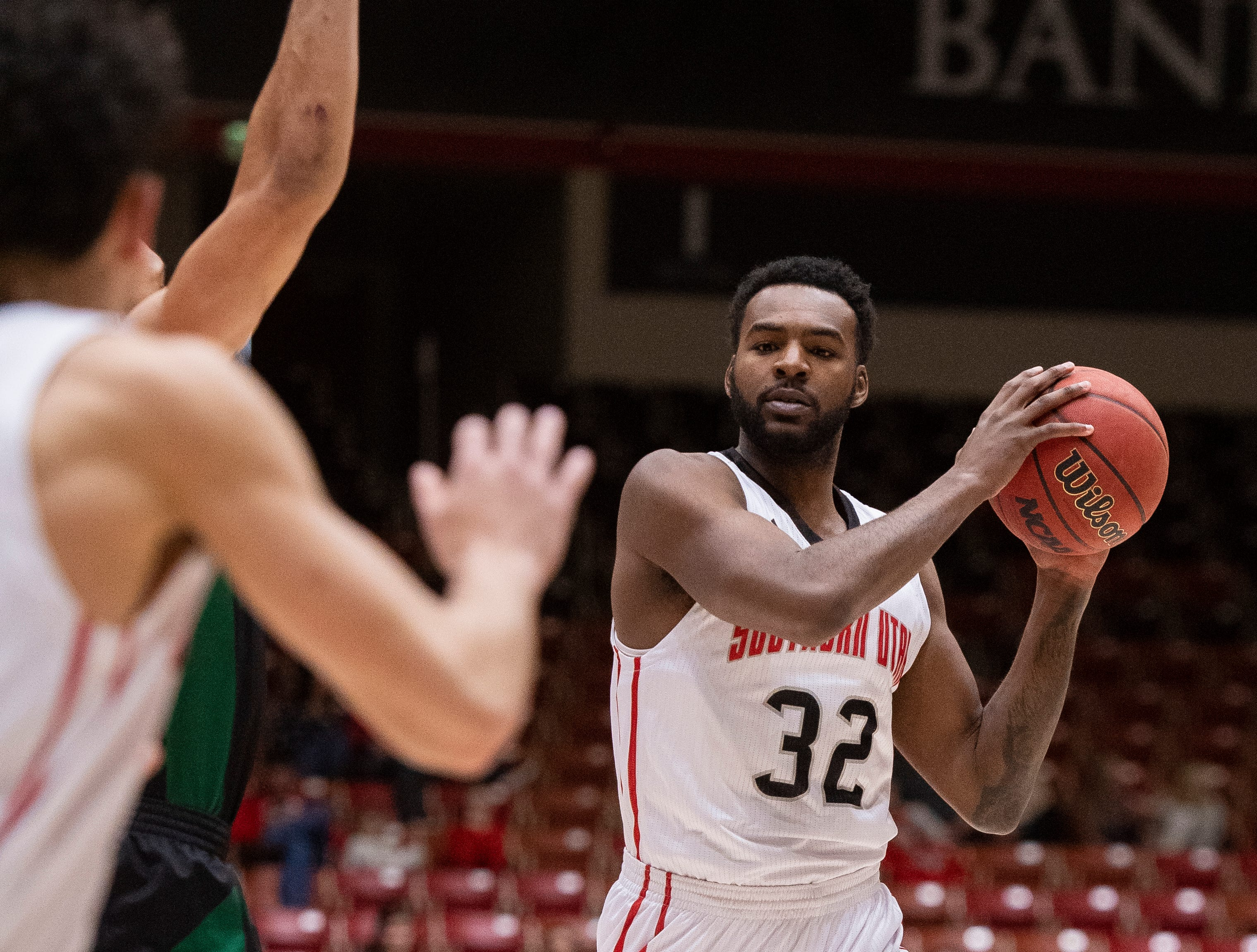 Southern Utah University junior Andre Adams (32) looks for an open pass against Sacramento State in the America First Event Center Saturday, January 19, 2019.