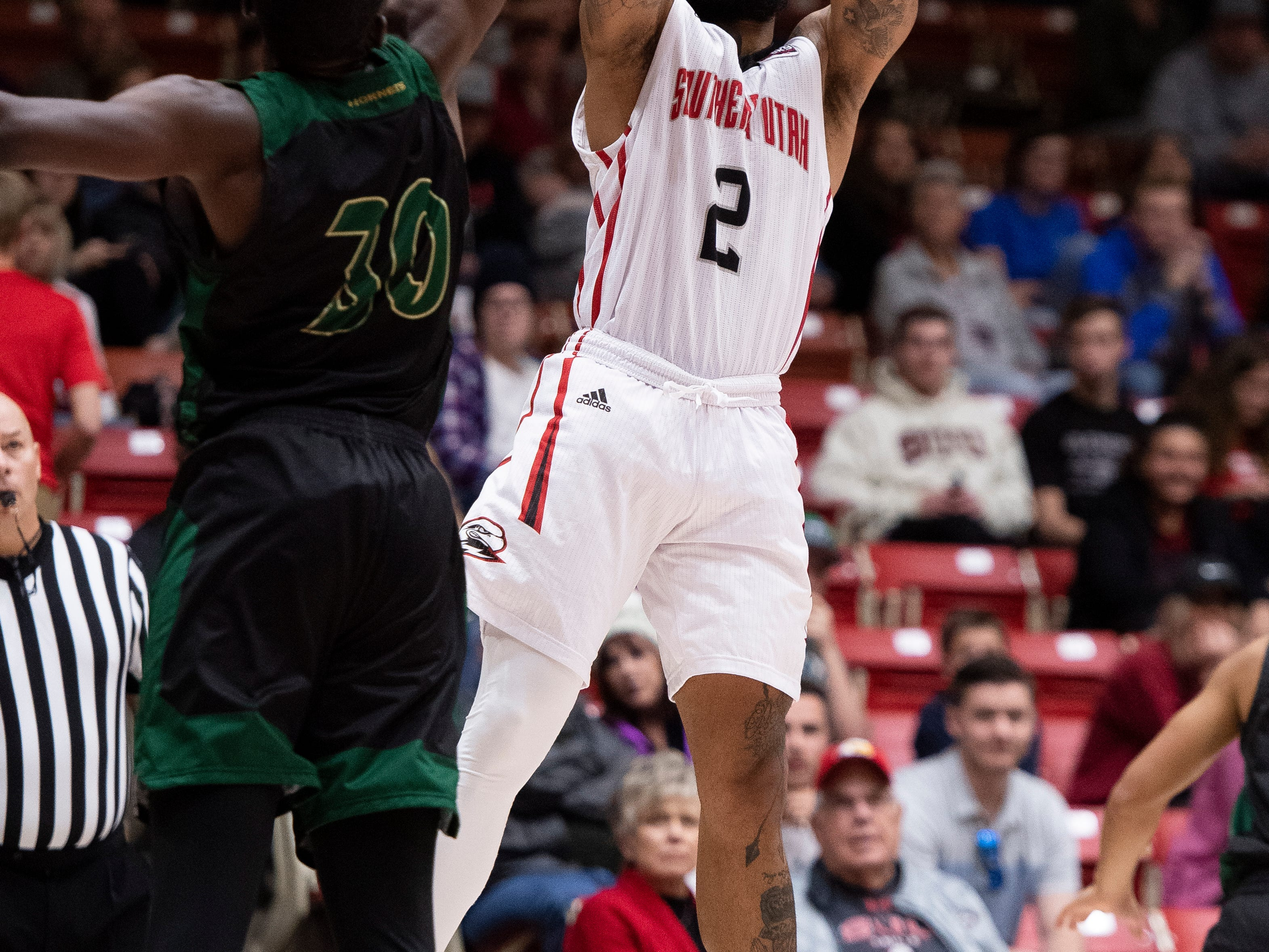 Southern Utah University senior Brandon Better (2) sinks a three-point basket against Sacramento State in the America First Event Center Saturday, January 19, 2019.