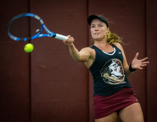 Carla Touly returns a serve for Florida State.