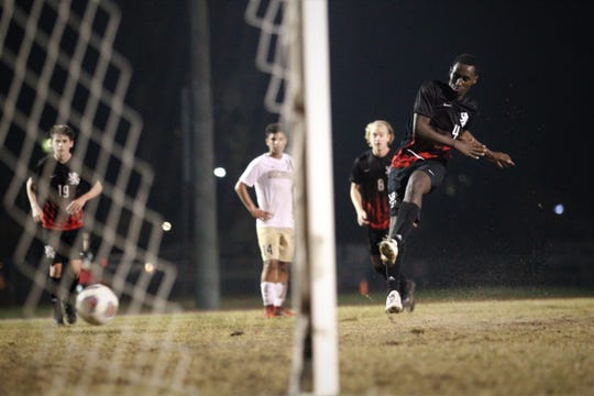 Leon's Ky Peltier drills a goal on a penalty kick as Leon beat Gainesville Buchholz 5-2 on Jan. 18, 2019 to improve to 18-0-1 while being ranked No. 1 nationally.