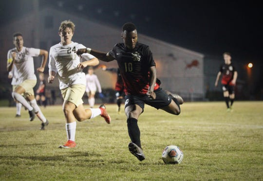 Leon's Jaden Jones-Riley fires a shot for a goal as Leon beat Gainesville Buchholz 5-2 on Jan. 18, 2019 to improve to 18-0-1 while being ranked No. 1 nationally.