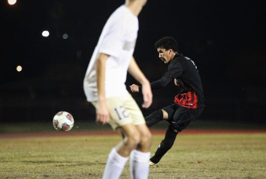Leon's Sy Fontenot drills a free kick into the back of the net as Leon beat Gainesville Buchholz 5-2 on Jan. 18, 2019 to improve to 18-0-1 while being ranked No. 1 nationally.