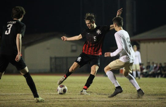 Leon's Collins Proctor gets off a shot on goal as Leon beat Gainesville Buchholz 5-2 on Jan. 18, 2019 to improve to 18-0-1 while being ranked No. 1 nationally.