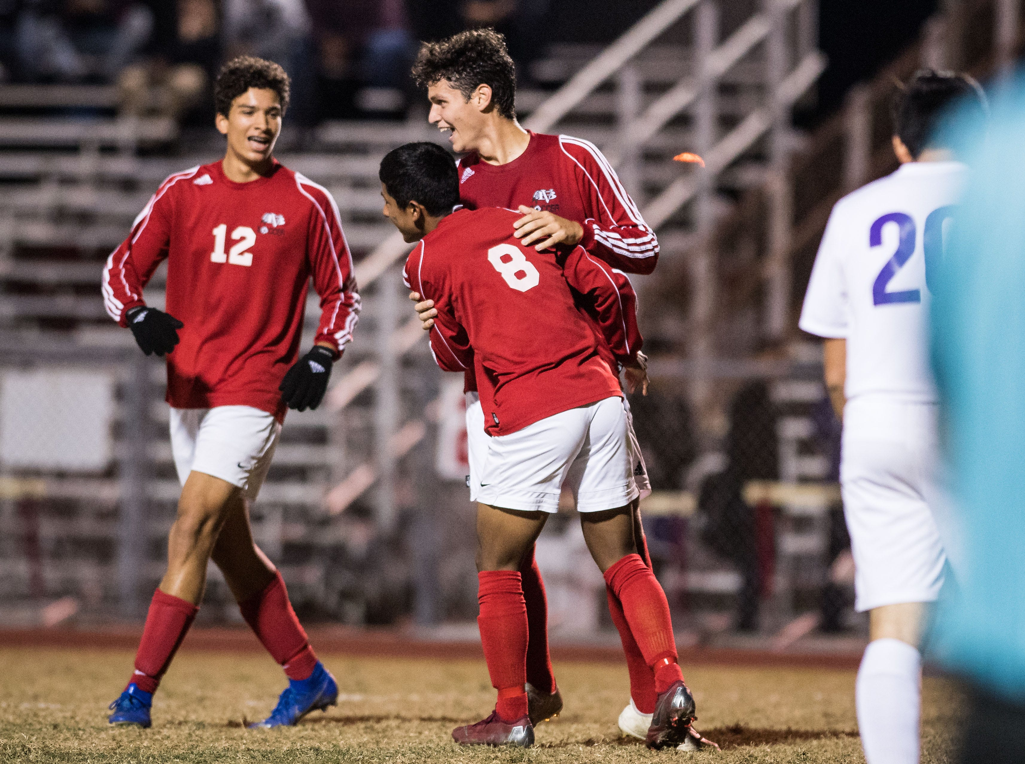Vero Beach's Marcos Carmona (8) is congratulated by Rodrigo Caldas, as teammate Gabriel Espinosa approaches at left, after scoring the team's second goal against Okeechobee during the  first half of the high school boys soccer game Friday, Jan. 18, 2019, at Vero Beach High School.