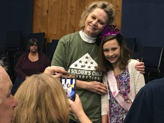 Evelyn Knightly, right, was given her 10th birthday party by A Soldier's Child Foundation and Central Assembly of God in Indian River County Saturday. Laura Kennedy, left, of Vero Beach, volunteered to help with the party.