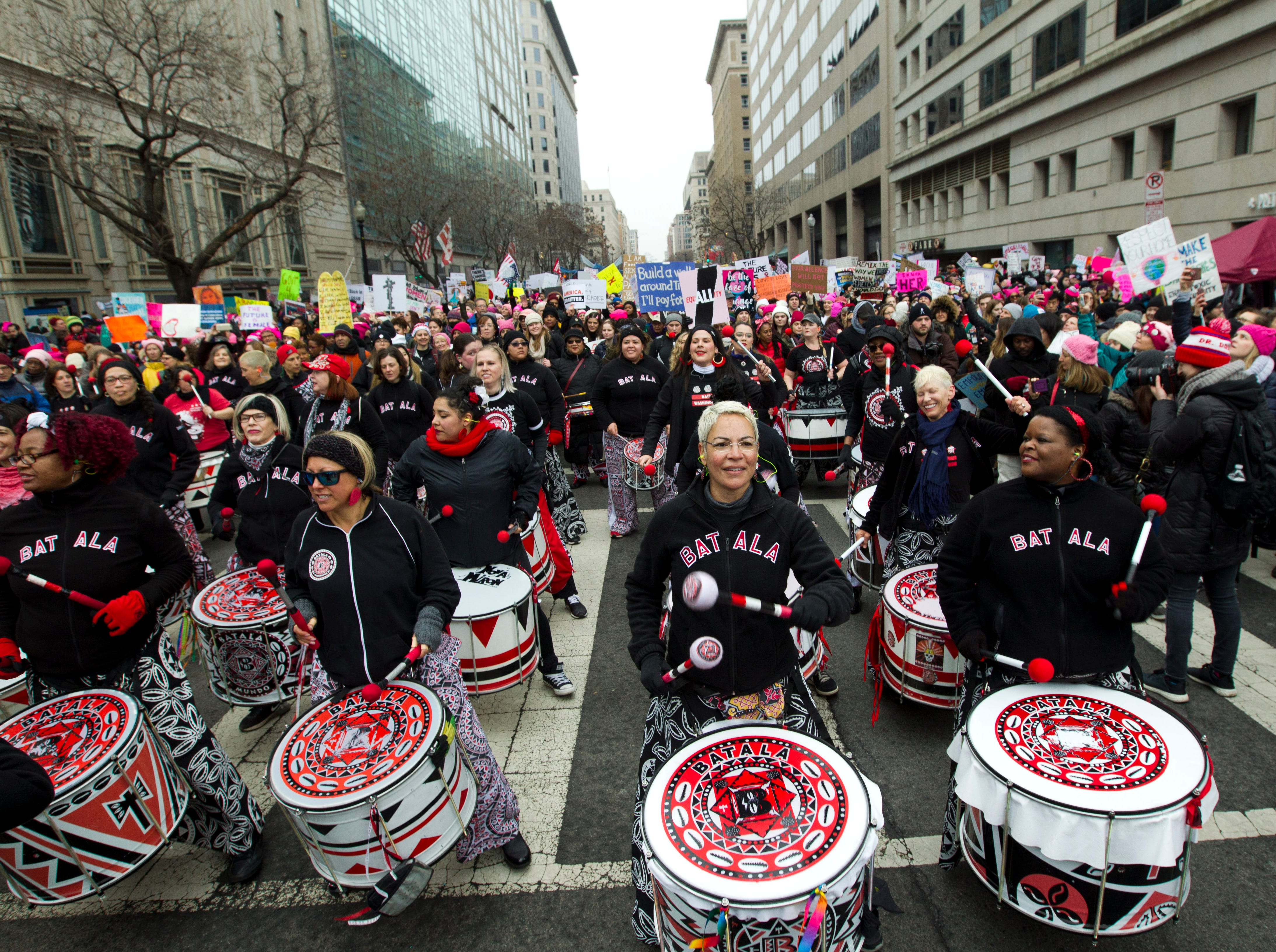 The drummer group Batala performs with demonstrators during the Women's March in Washington on Saturday, Jan. 19, 2019.