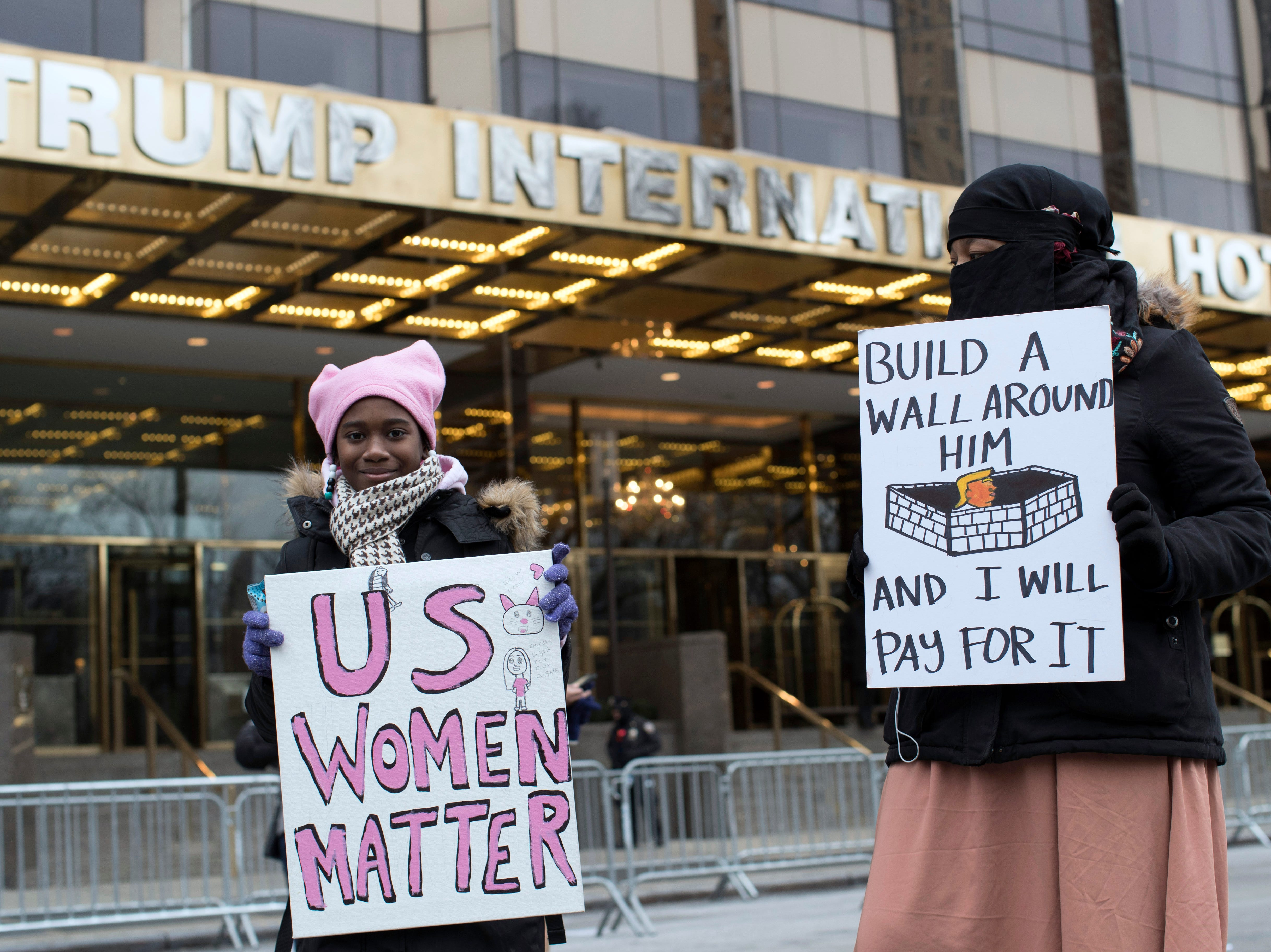 Demonstrators march past the Trump International Hotel and Tower during the Womens's March Alliance, Saturday, Jan. 19, 2019, in New York. One procession, a march through midtown Manhattan, is being organized by the Women's March Alliance, a nonprofit group whose leaders are putting on their demonstration for the third straight year. Another event, a downtown Manhattan rally held at roughly the same time Saturday, is being organized by the New York City chapter of Women's March Inc., the group formed to help organize the 2017 demonstration in Washington, D.C.