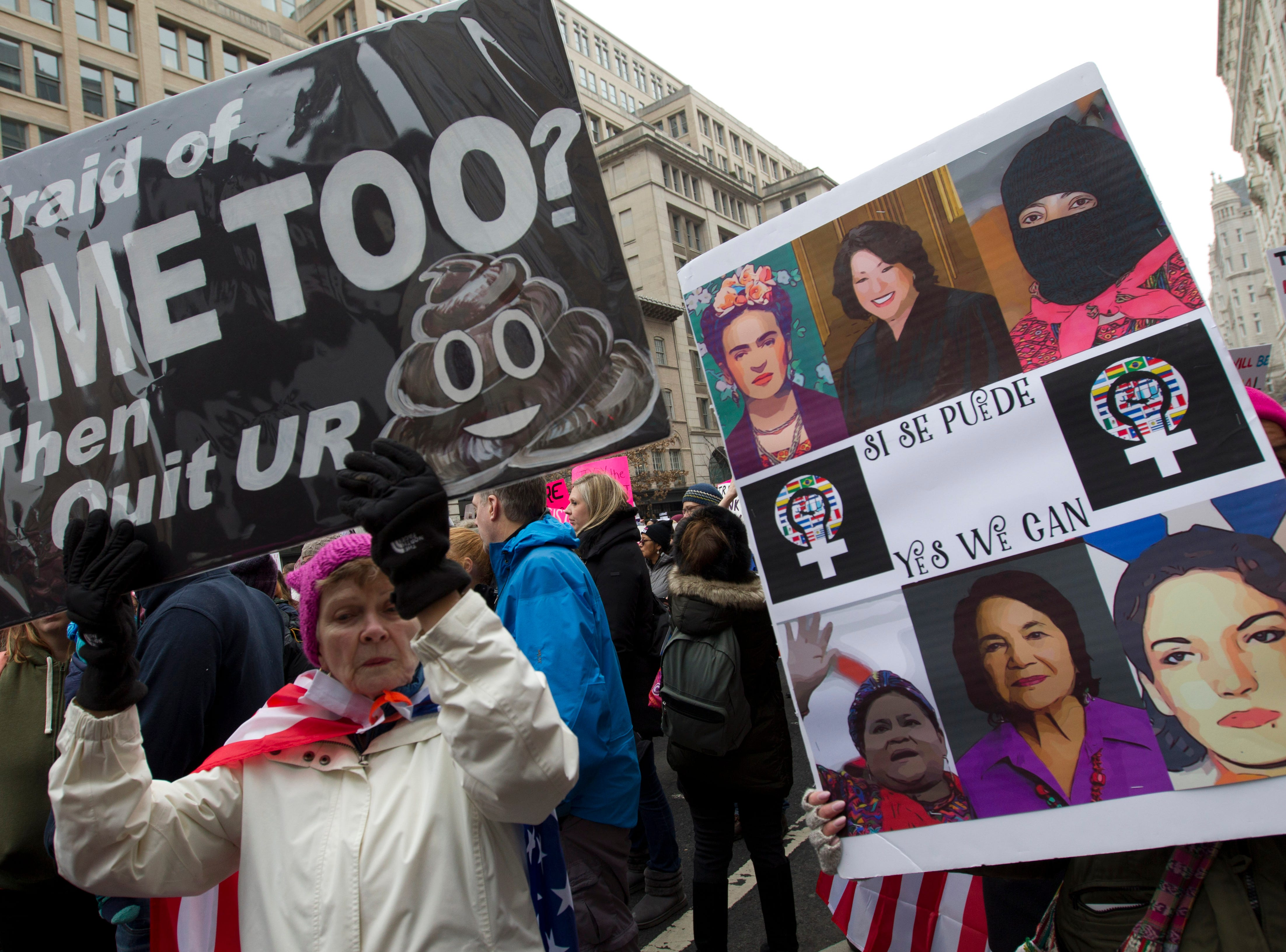Demonstrators hold signs during the Women's March in Washington on Saturday, Jan. 19, 2019.