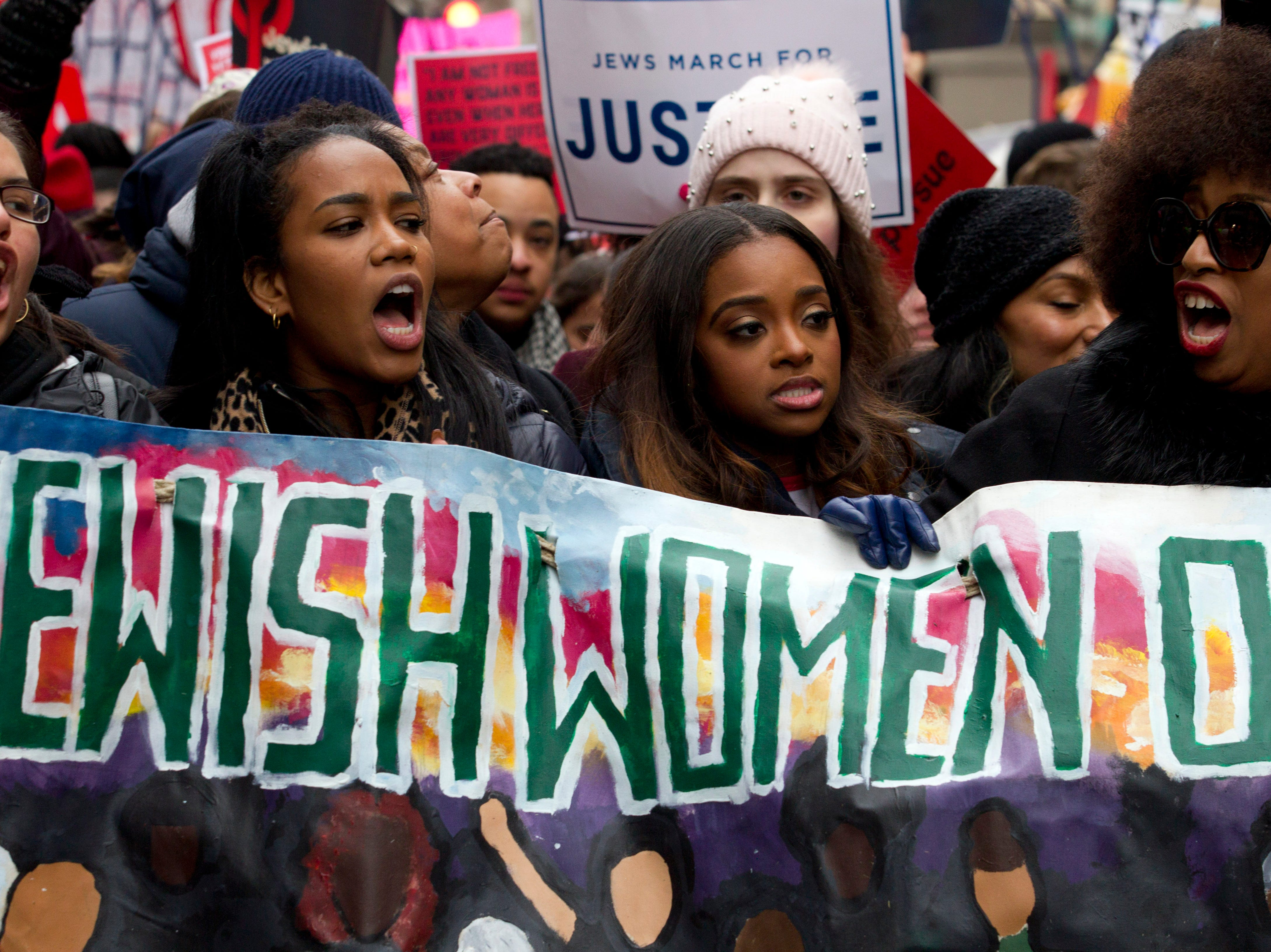 Co-president of the 2019 Women's March Tamika Mallory, center, joins other demonstrators on Pennsylvania Avenue during the Women's March in Washington on Saturday, Jan. 19, 2019.