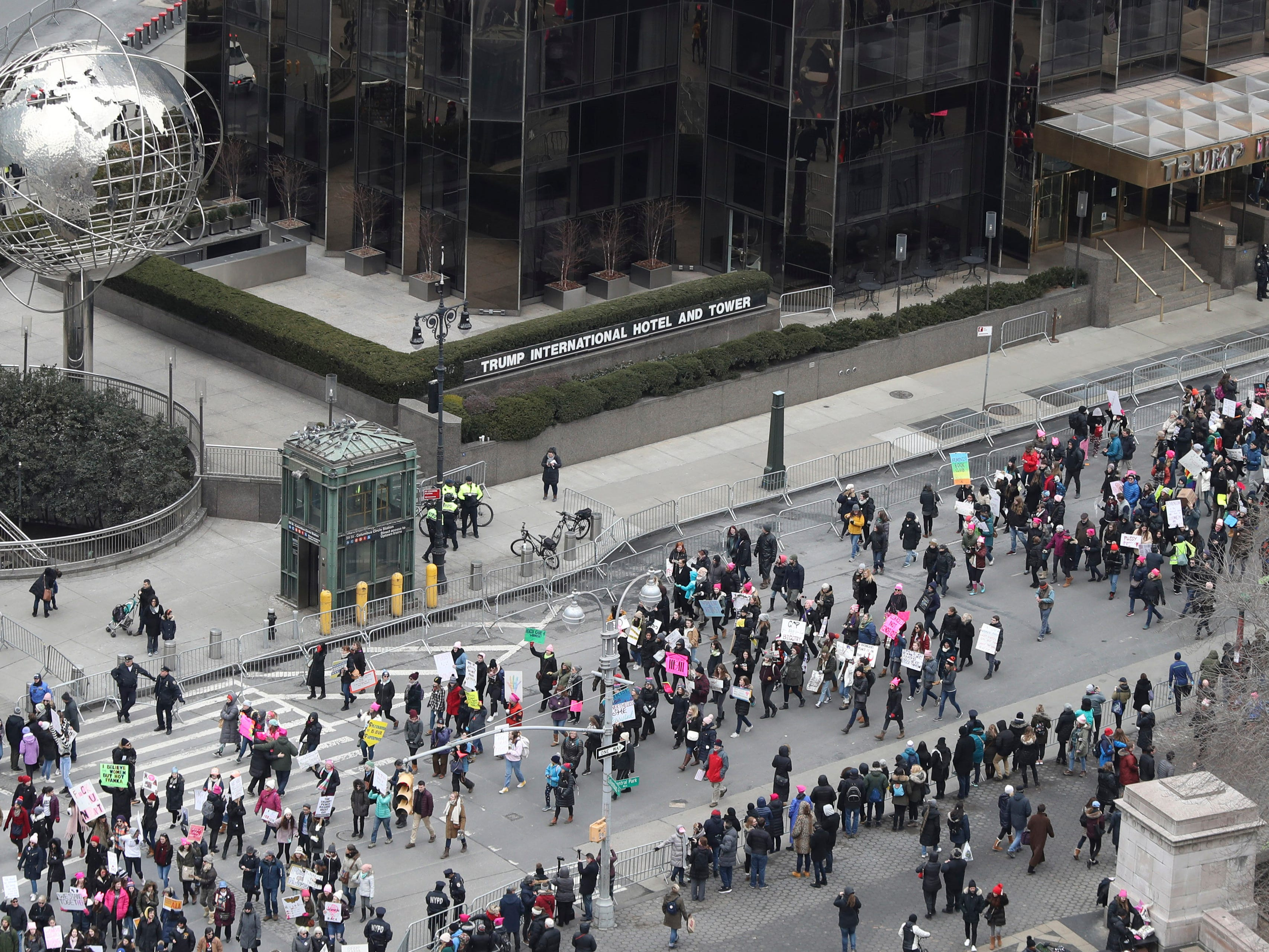 Demonstrators march past the Trump International Hotel and Tower during the Women's March Alliance, Saturday, Jan. 19, 2019, in New York.
