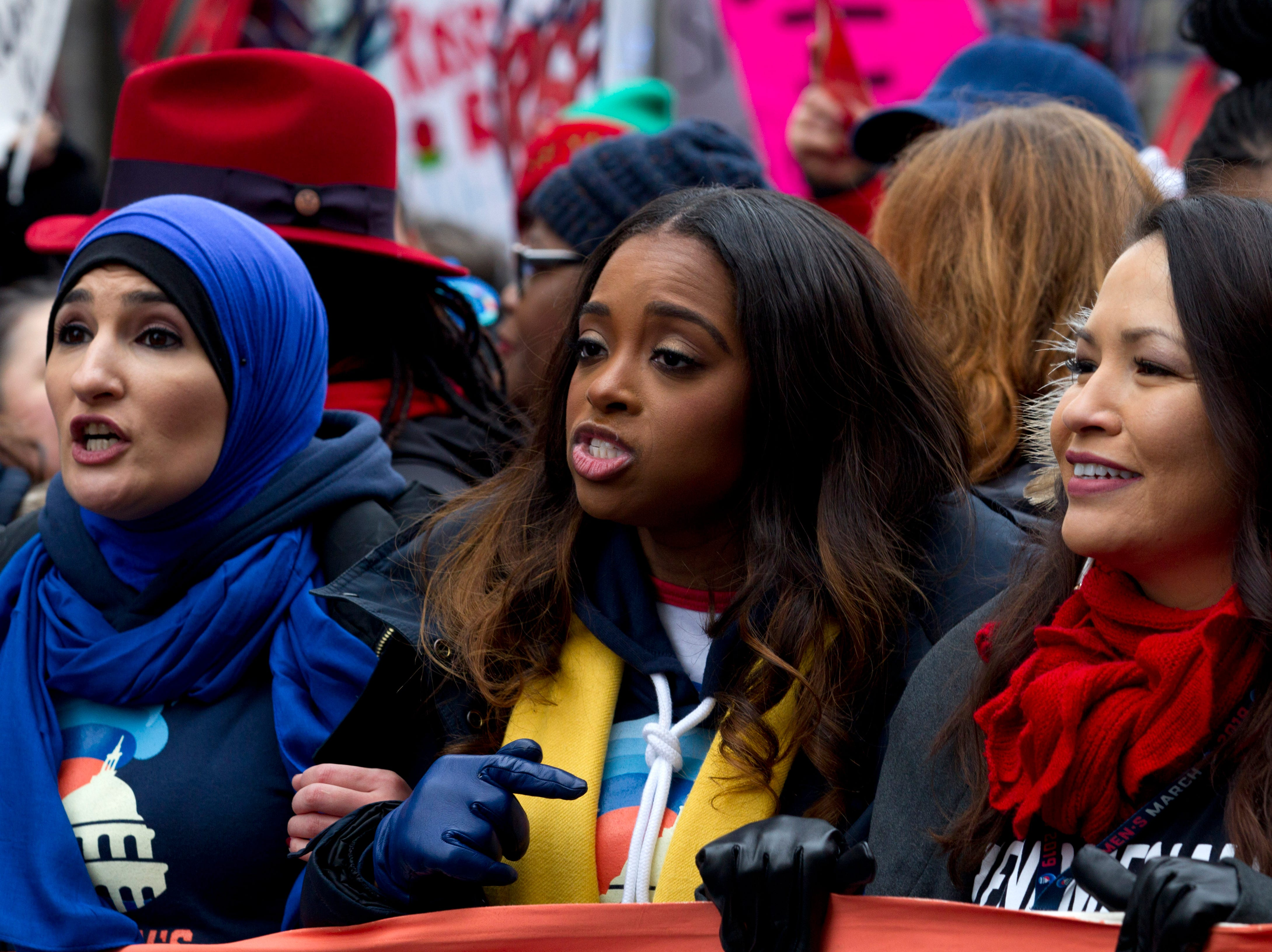 Co-presidents of the 2019 Women's March, Linda Sarsour, left, and Tamika Mallory, center, join other demonstrators on Pennsylvania Avenue during the Women's March in Washington on Saturday, Jan. 19, 2019.