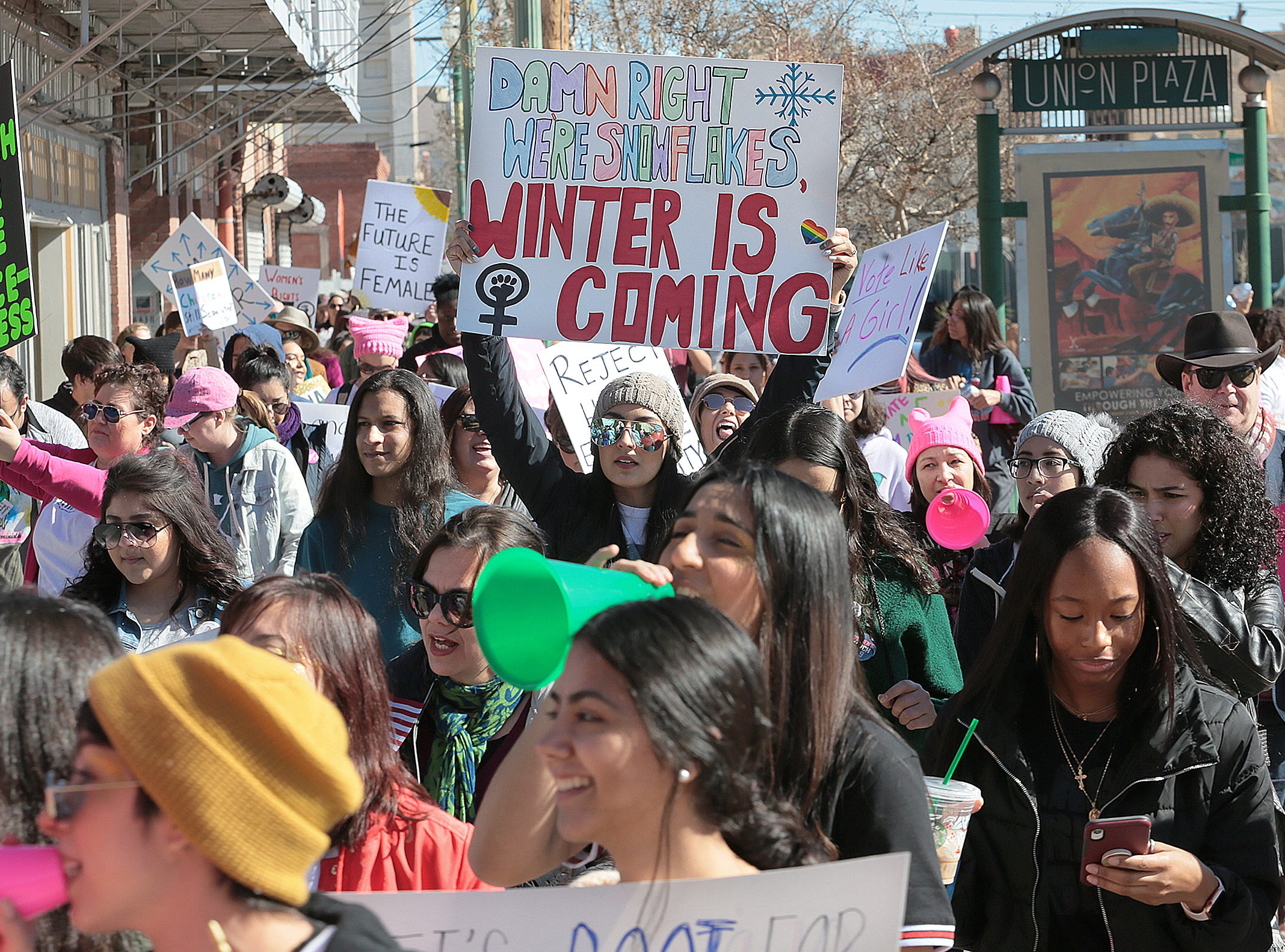 The El Paso Women's march makes its way through Union Plaza Saturday before returning to San Jacinto Plaza where a rally was held.