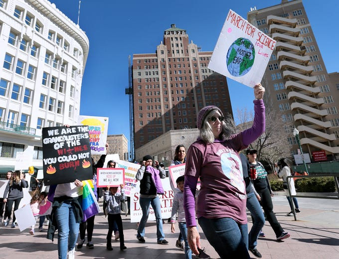 Women march from San Jacinto Plaza through the streets of Downtown El Paso on Saturday, Jan. 19, 2019, during the El Paso Women's March.