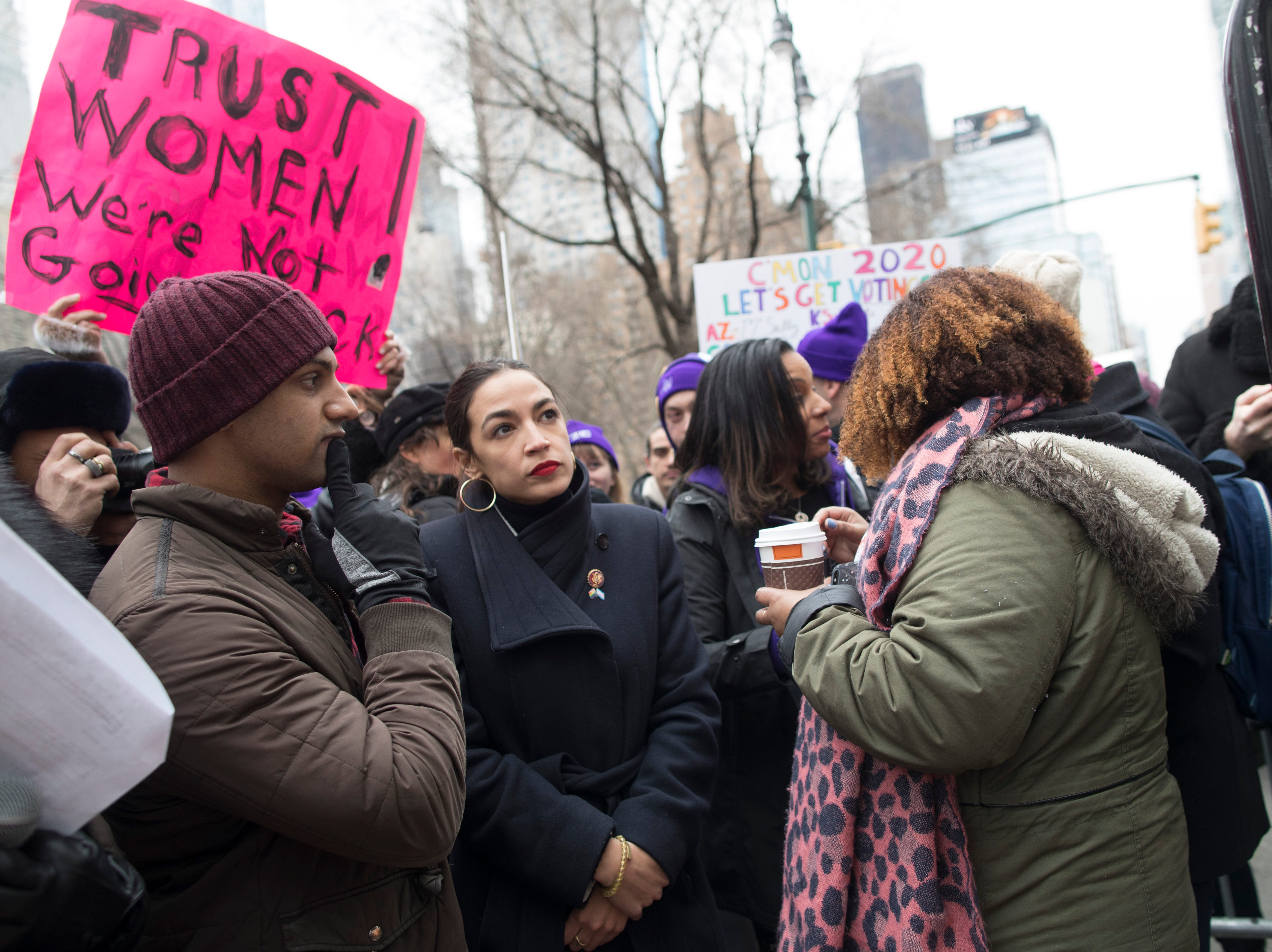 Rep. Alexandria Ocasio-Cortez, D-N.Y., waits backstage during the Women's March Alliance, Saturday, Jan. 19, 2019, in New York.