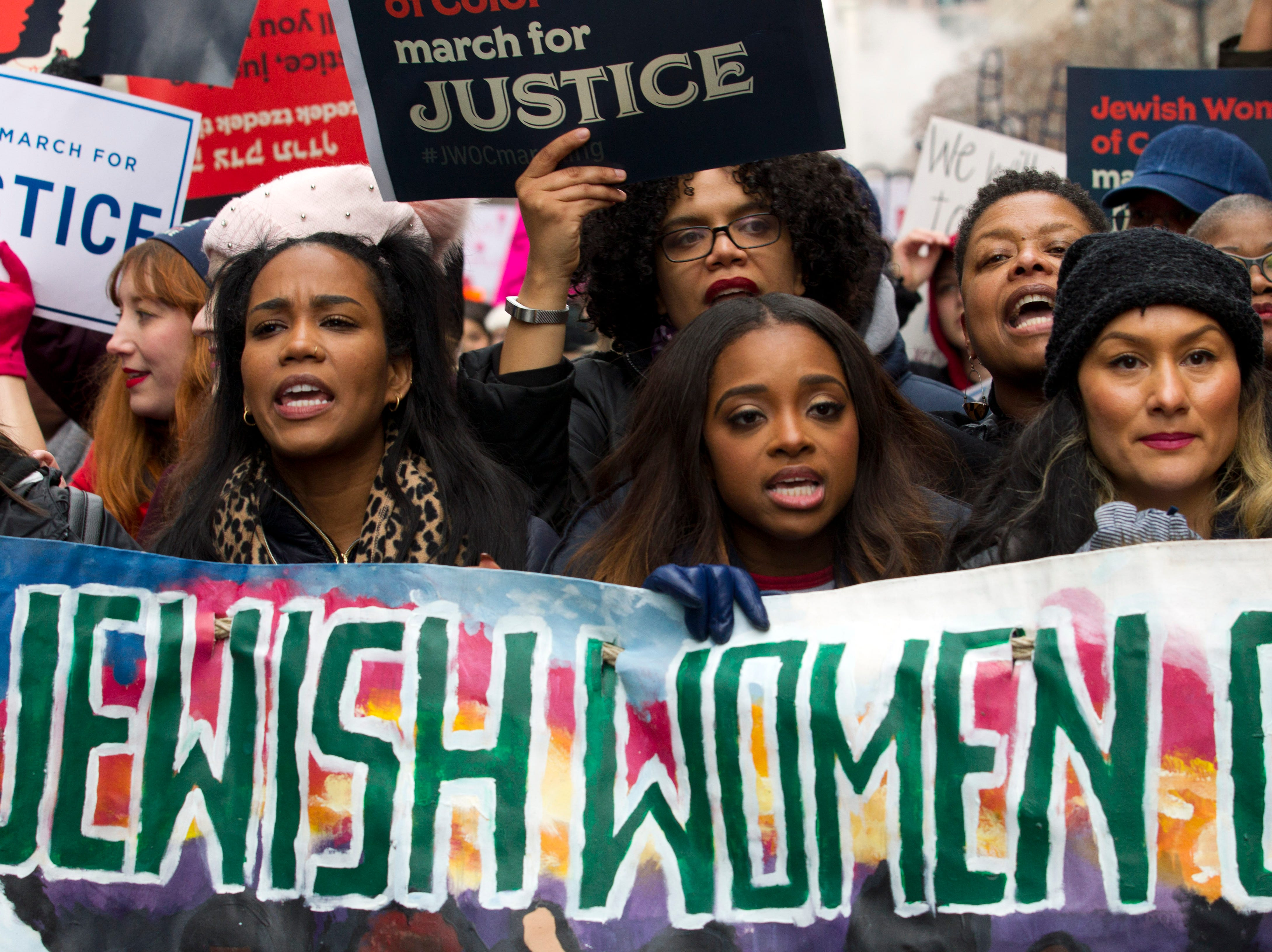 Co-president of the 2019 Women's March, Tamika Mallory, center, joins other demonstrators on Pennsylvania Avenue during the Women's March in Washington on Saturday, Jan. 19, 2019.