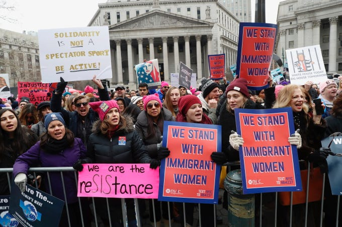 Participants take part in a Women's rally in lower Manhattan on Saturday, Jan. 19, 2019 in New York.   A march through midtown Manhattan is being organized by the Women's March Alliance for the third year. But the downtown Manhattan rally at roughly the same time is being organized by a chapter of Women's March Inc., the group formed to help organize the 2017 demonstration in Washington. Women's March Inc. co-leader Tamika Mallory, who is black, has come under her fire from Jewish groups for her support of Nation of Islam leader Louis Farrakhan, who is known partly for his anti-Semitic rhetoric and condemnations of homosexuality.