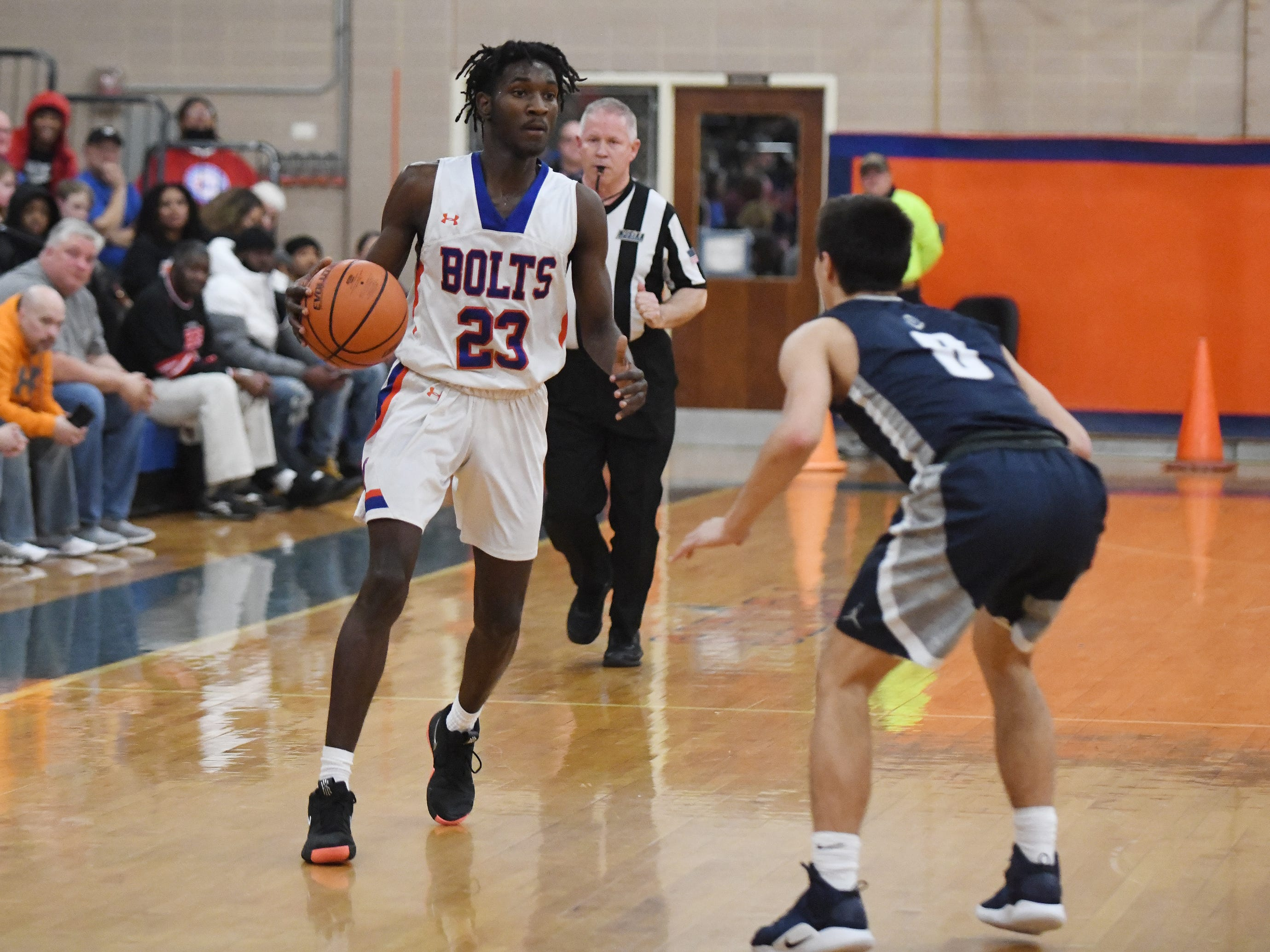 Millville's Rynell Lawrence looks to pass the ball during a game against St. Augustine. The Hermits topped the Thunderbolts 66-53 on Friday, Jan. 18, 2019.