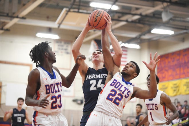 St. Augustine's Matthew Delaney grabs the ball against Millville. The Hermits topped the Thunderbolts 66-53 on Friday, Jan. 18, 2019.