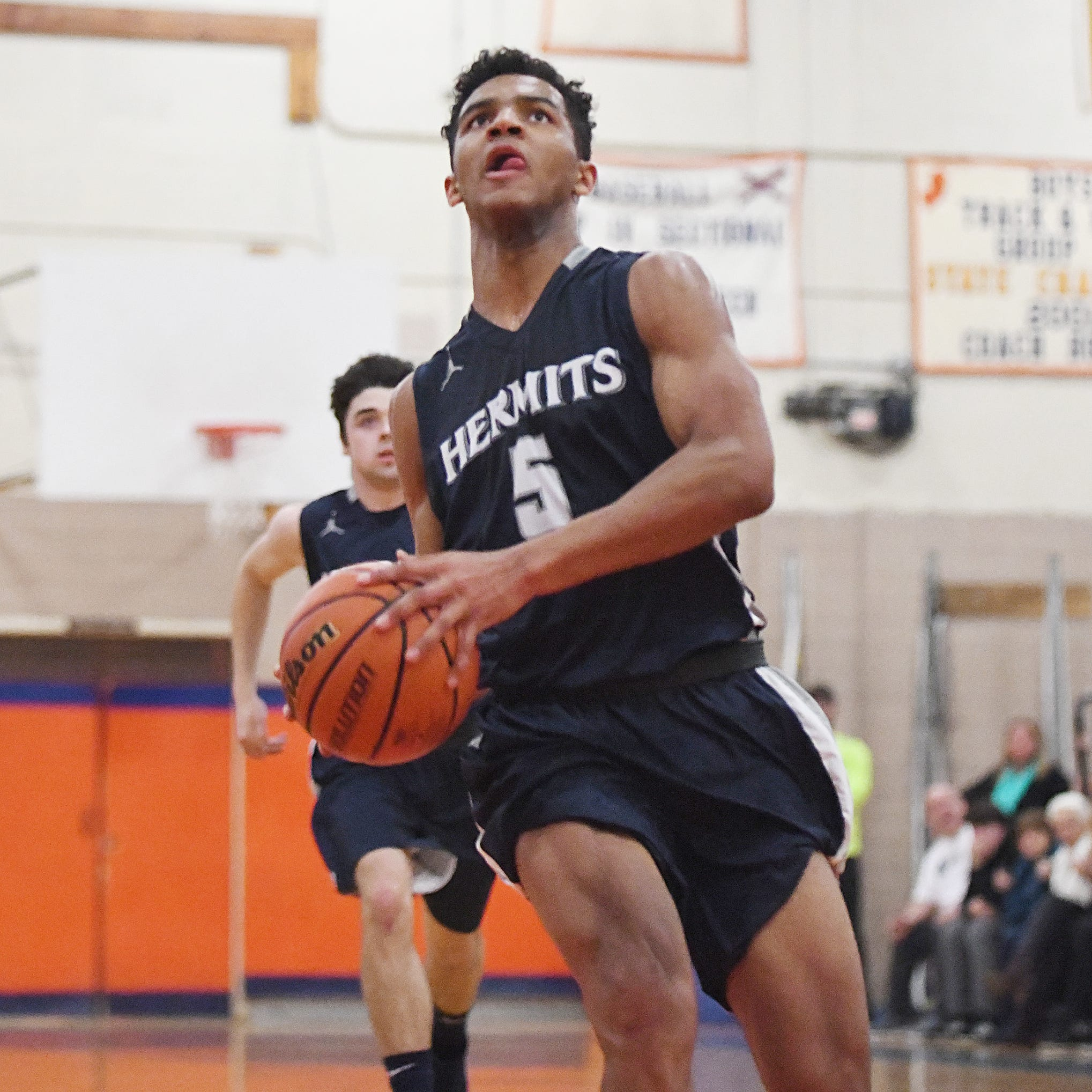 St. Augustine's Charles Solomon scores during a game against Millville. The Hermits topped the Thunderbolts 66-53 on Friday, Jan. 18, 2019.