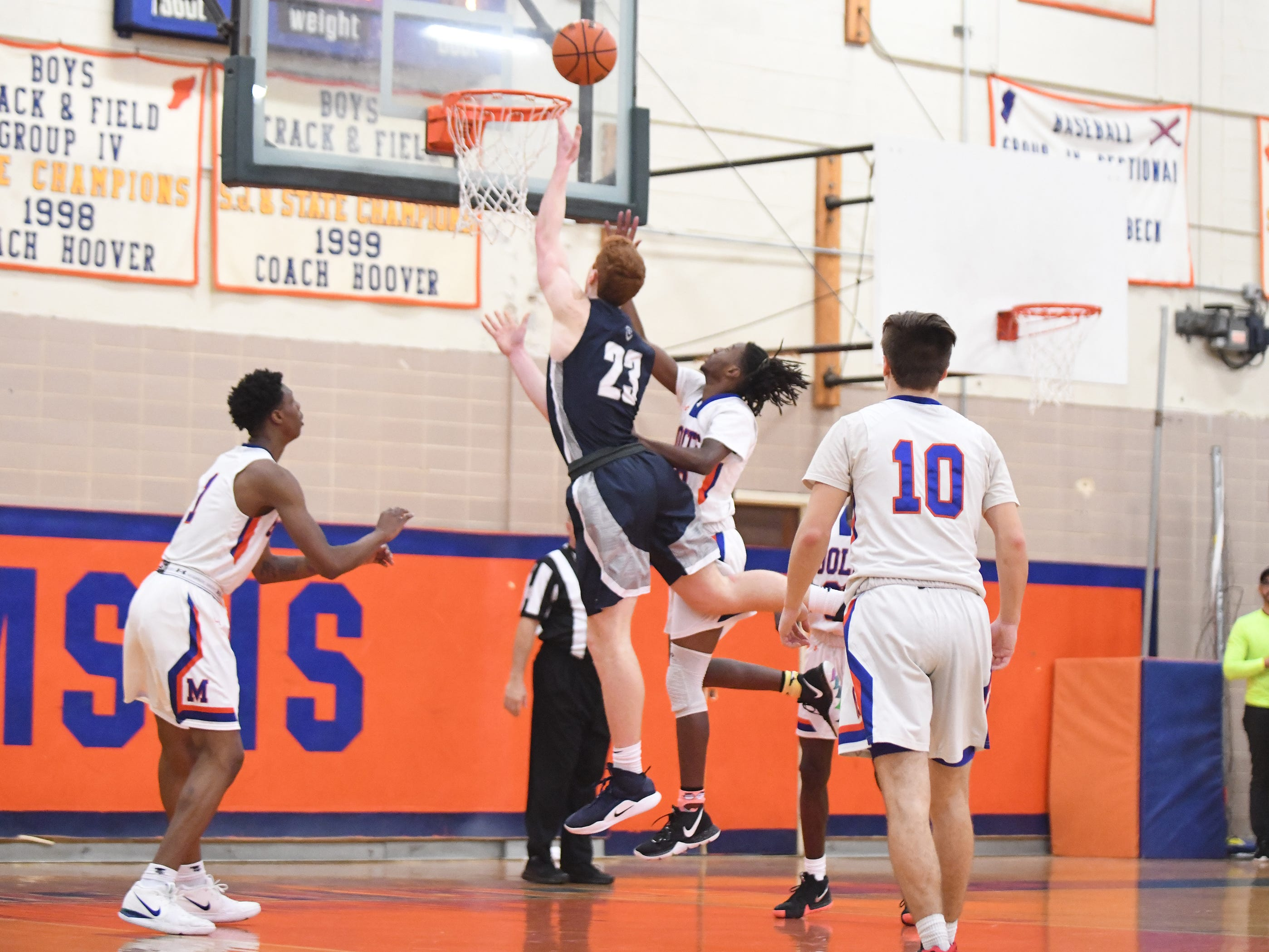 St. Augustine's Andrew Delaney scores during a game against Millville. The Hermits topped the Thunderbolts 66-53 on Friday, Jan. 18, 2019.