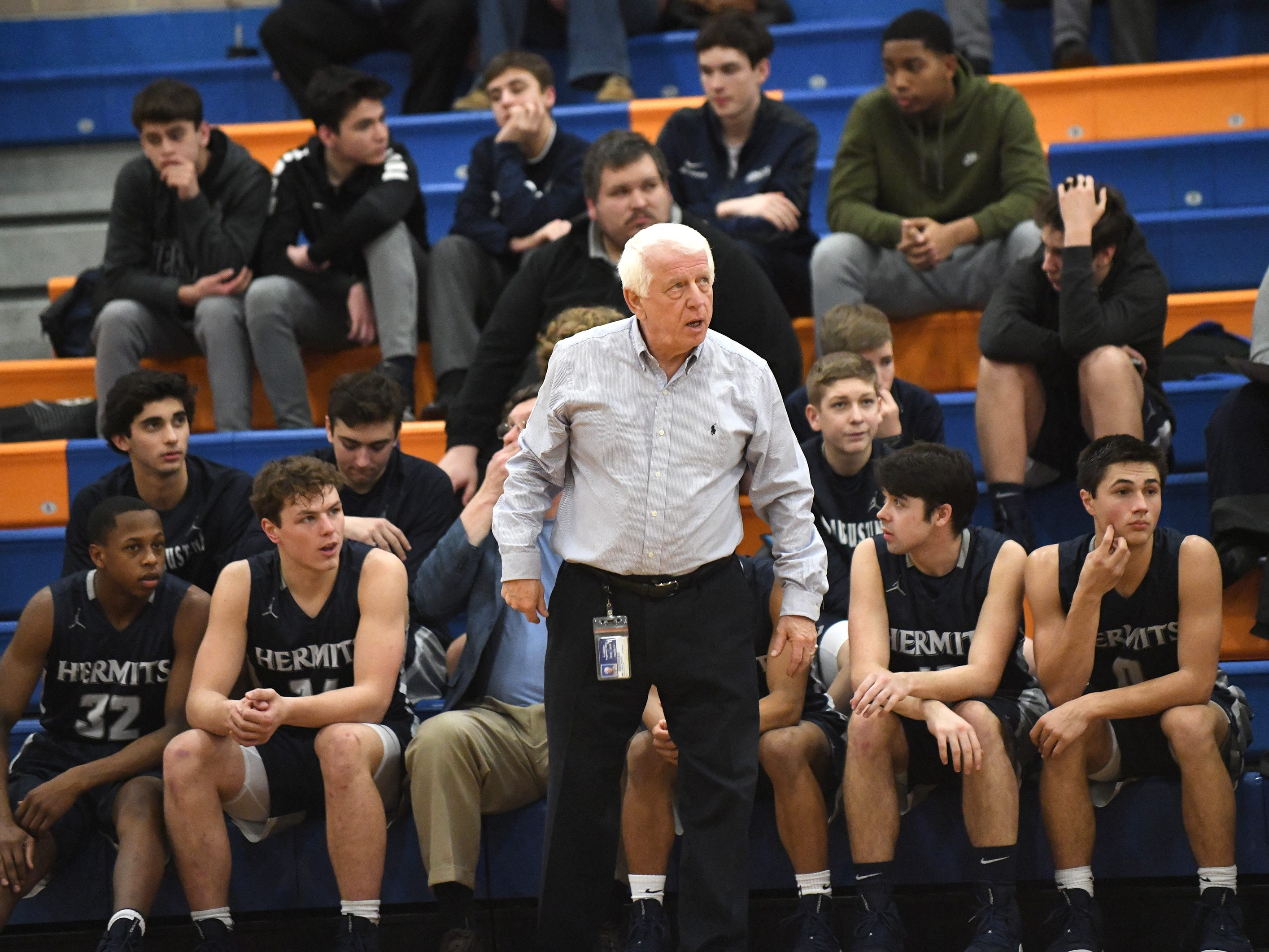 St. Augustine's head coach Paul Rodio stands near the team during a game against Millville. The Hermits topped the Thunderbolts 66-53 on Friday, Jan. 18, 2019.