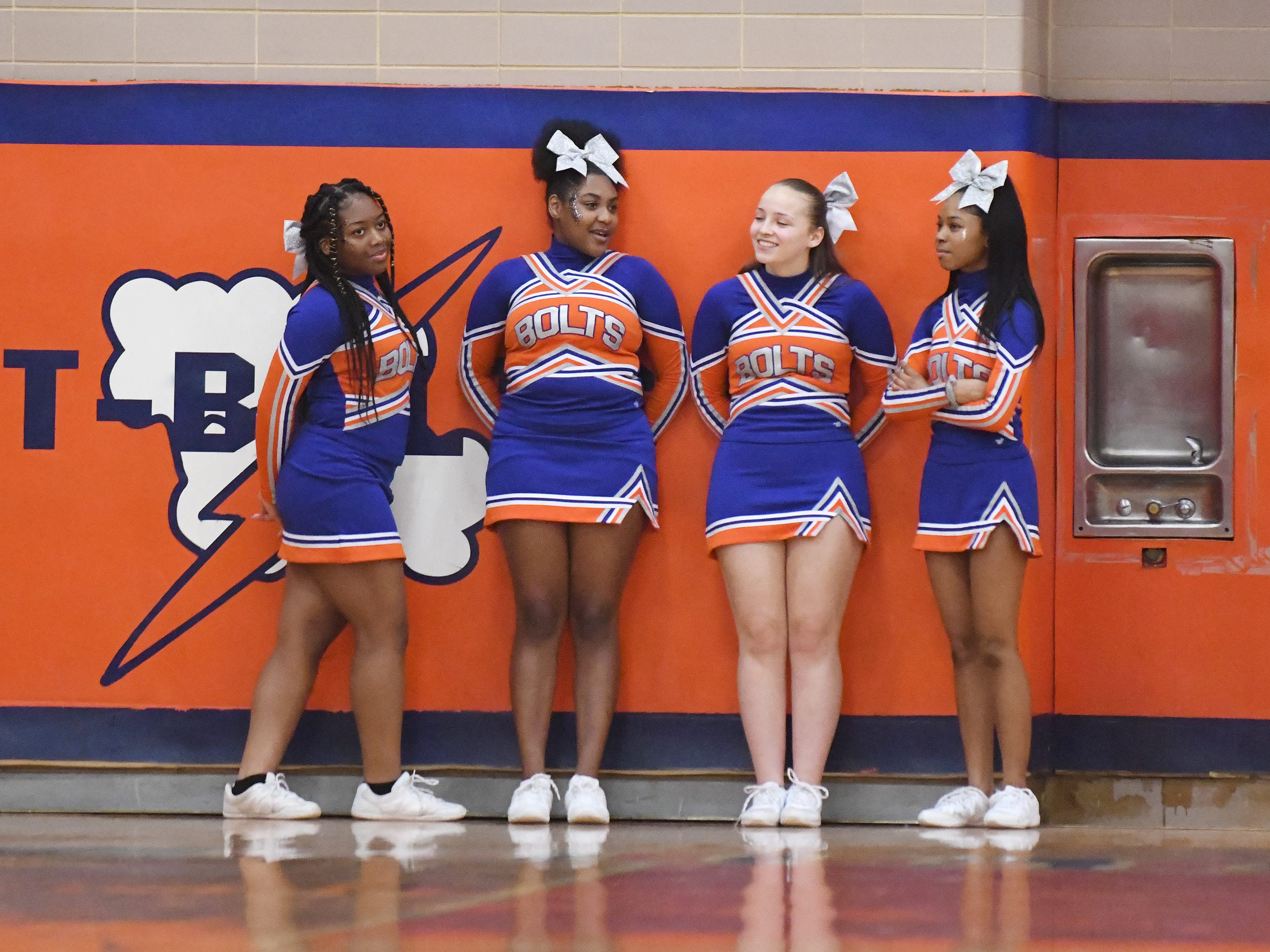 Millville cheerleaders get ready to perform during a boys basketball game against St. Augustine. The Hermits topped the Thunderbolts 66-53 on Friday, Jan. 18, 2019.