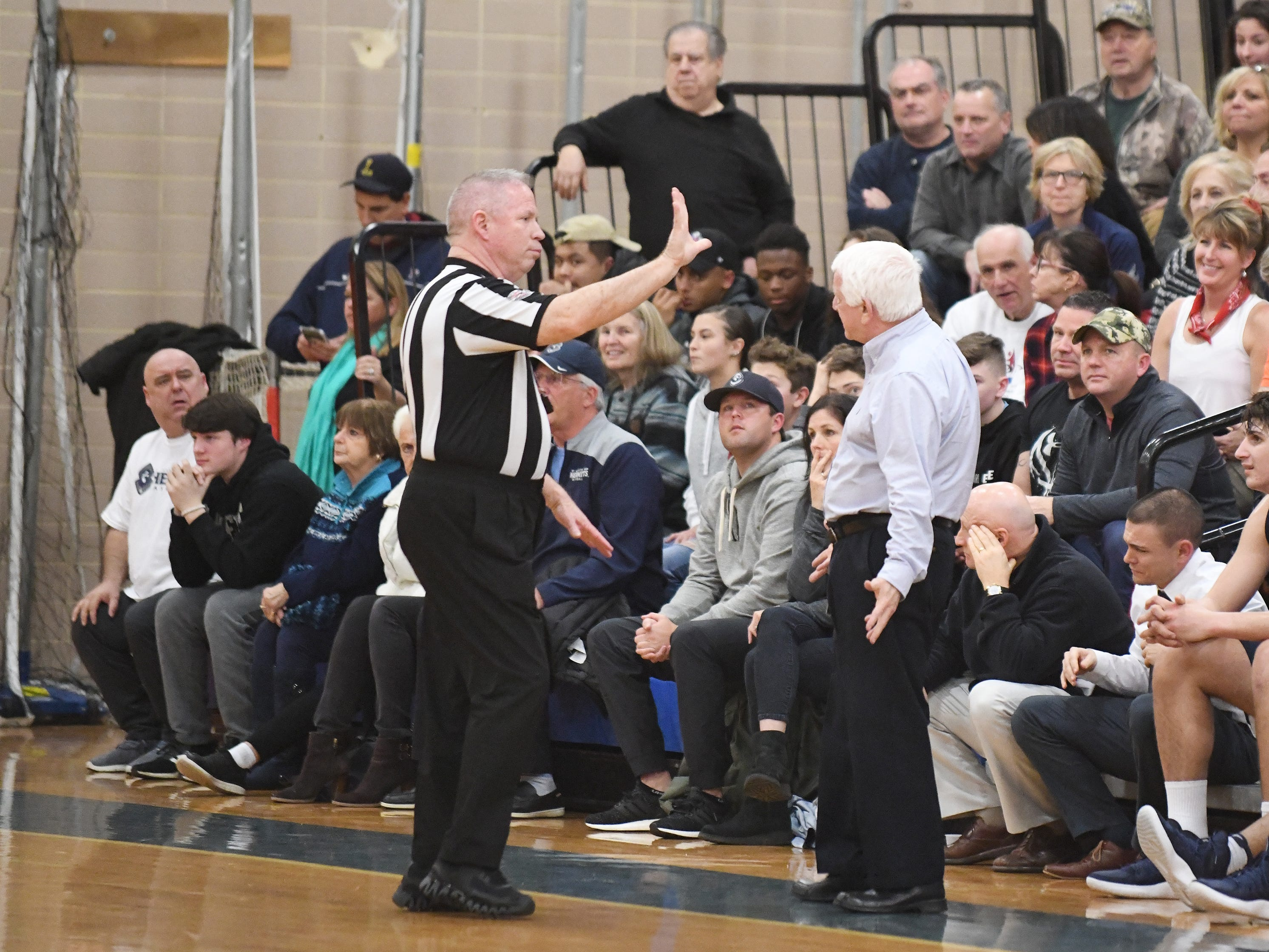 St. Augustine's head coach Paul Rodio argues a call during a game against Millville. The Hermits topped the Thunderbolts 66-53 on Friday, Jan. 18, 2019.