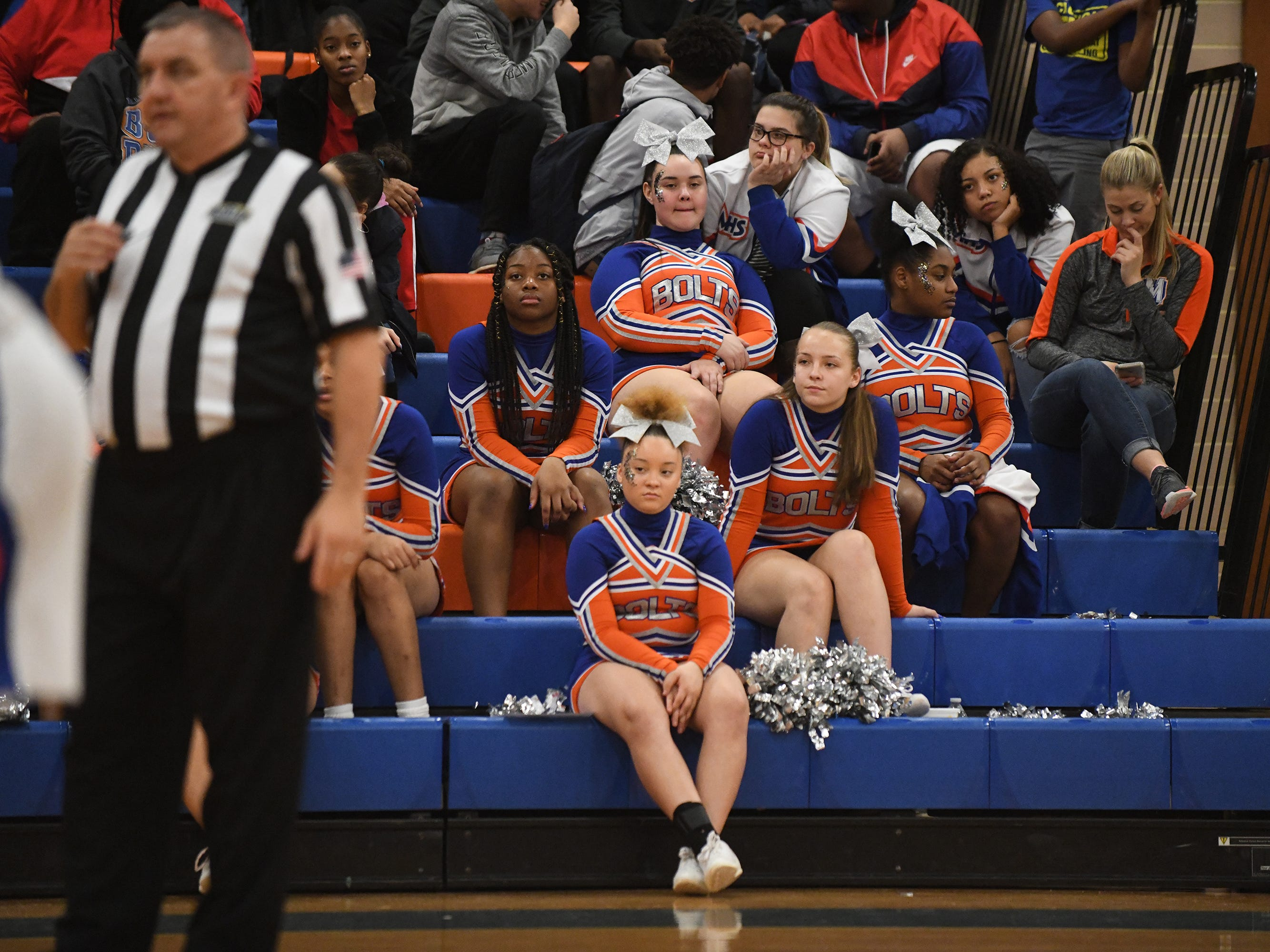 Millville cheerleaders watch a game against visiting St. Augustine. The Hermits topped the Thunderbolts 66-53 on Friday, Jan. 18, 2019.