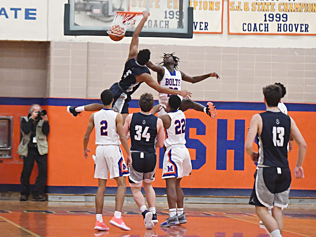St. Augustine's Charles Solomon dunks the ball while Millville's Rynell Lawrence tries to block. The Hermits topped the Thunderbolts 66-53 on Friday, Jan. 18, 2019.